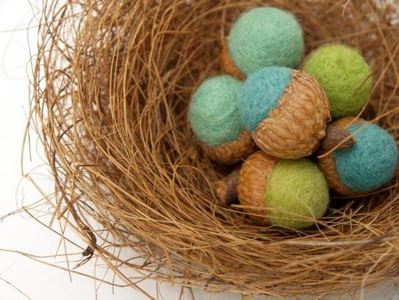 Natasha Lehrer crafts a tiny decorative acorns from sheep's wool and other fibers.