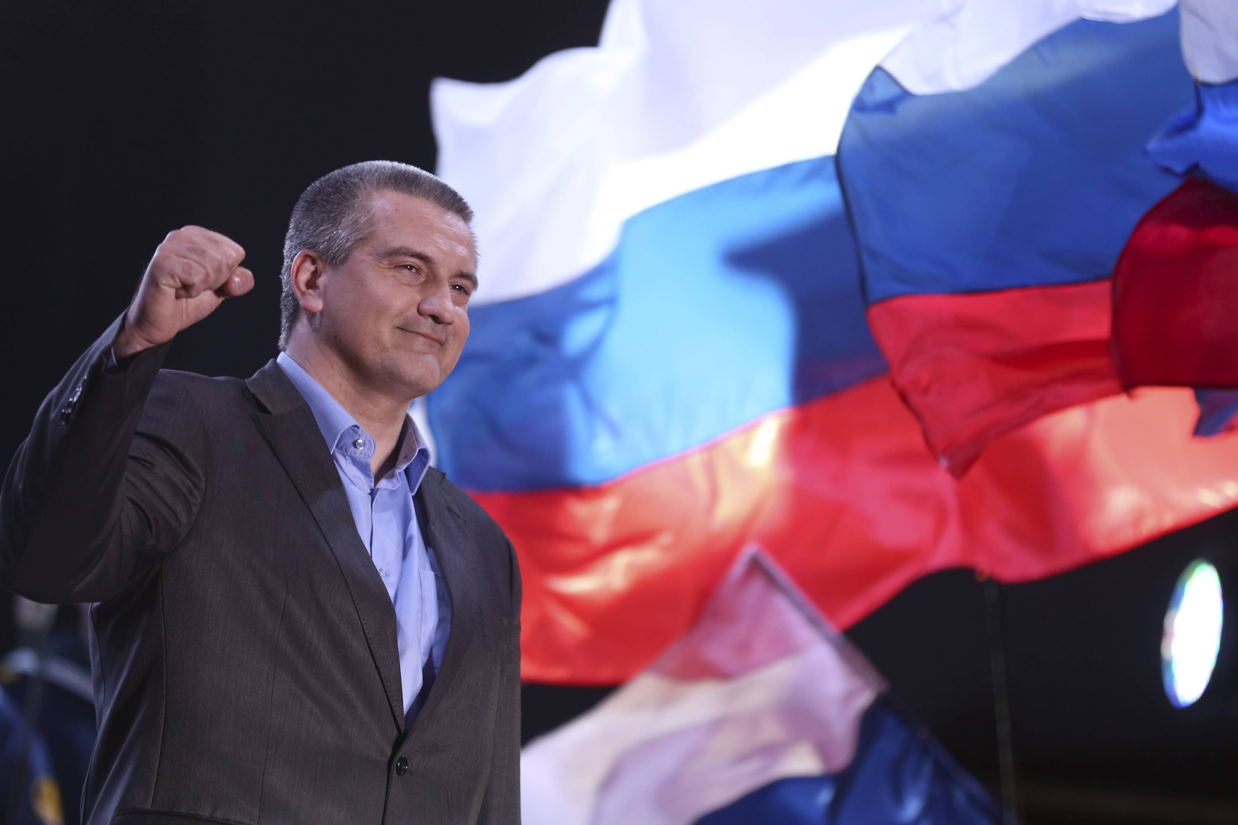 The head of Crimea's Russia-backed leader Sergei Aksyonov gestures as people celebrate in Lenin Square, Simferopol, Ukraine, Sunday. Crimeans voted overwhelmingly to secede from Ukraine and join Russia.