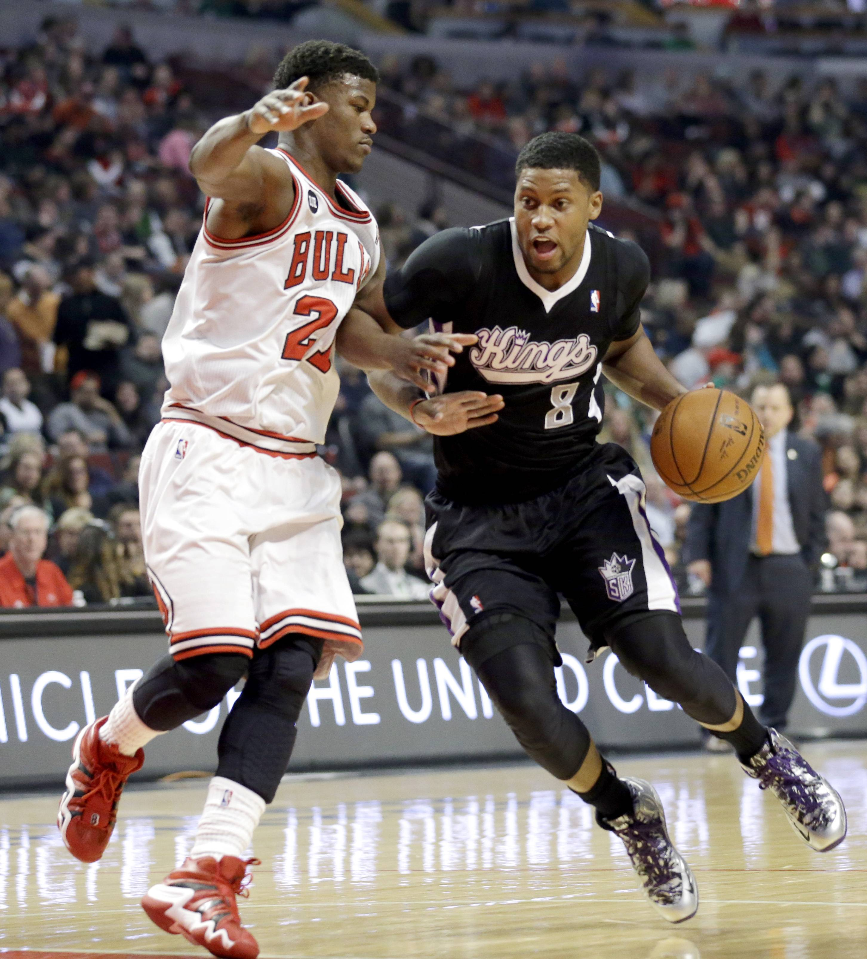 The Bulls' Jimmy Butler plays some tight defense on Kings forward Rudy Gay during Saturday night's victory over Sacramento.