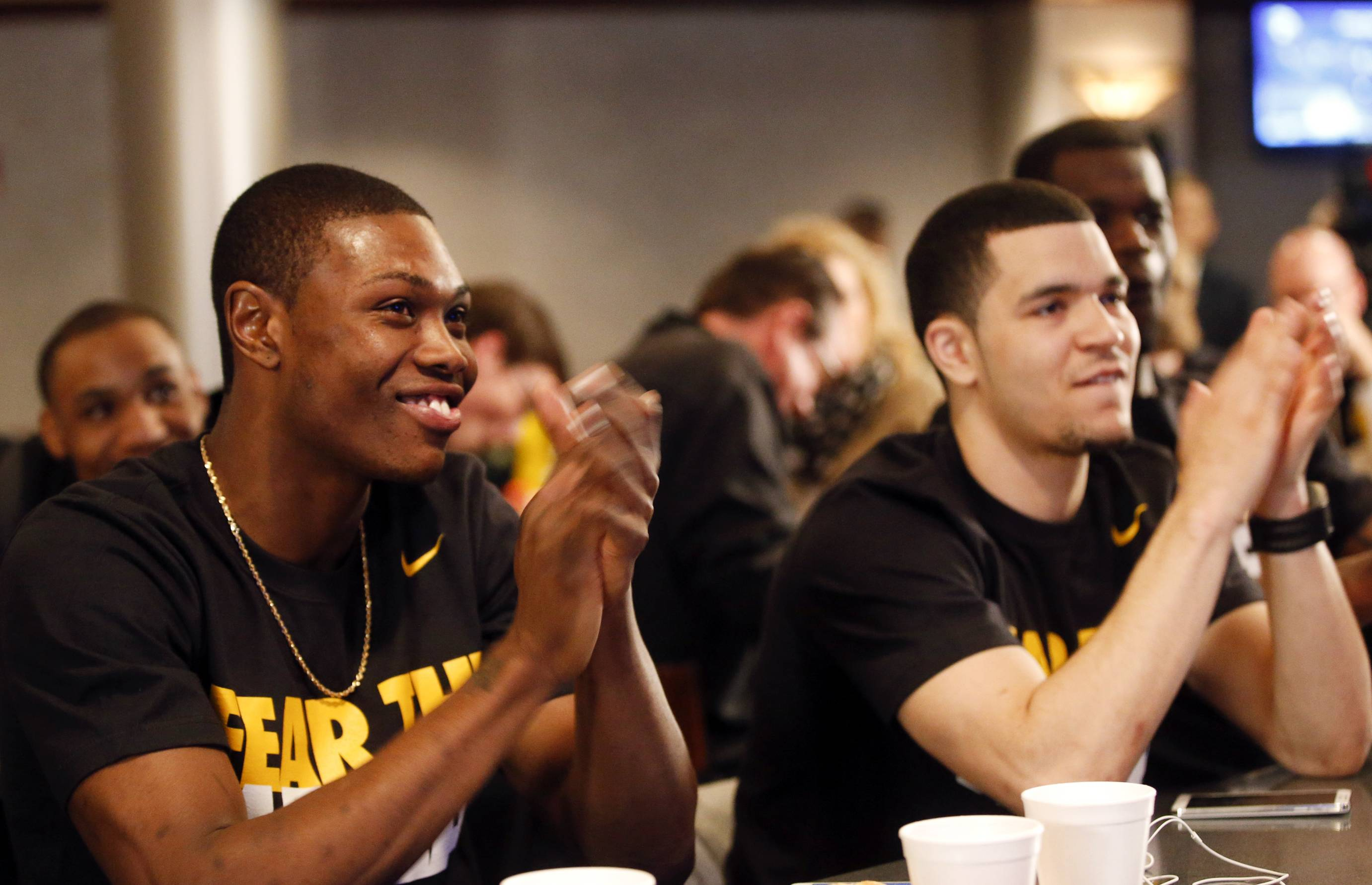 Wichita State's Cleanthony Early, left, and Fred VanVleet clap after the team earns a No. 1 seed during an NCAA college basketball Selection Sunday watch party, Sunday, March 16, 2014, in Wichita, Kan.