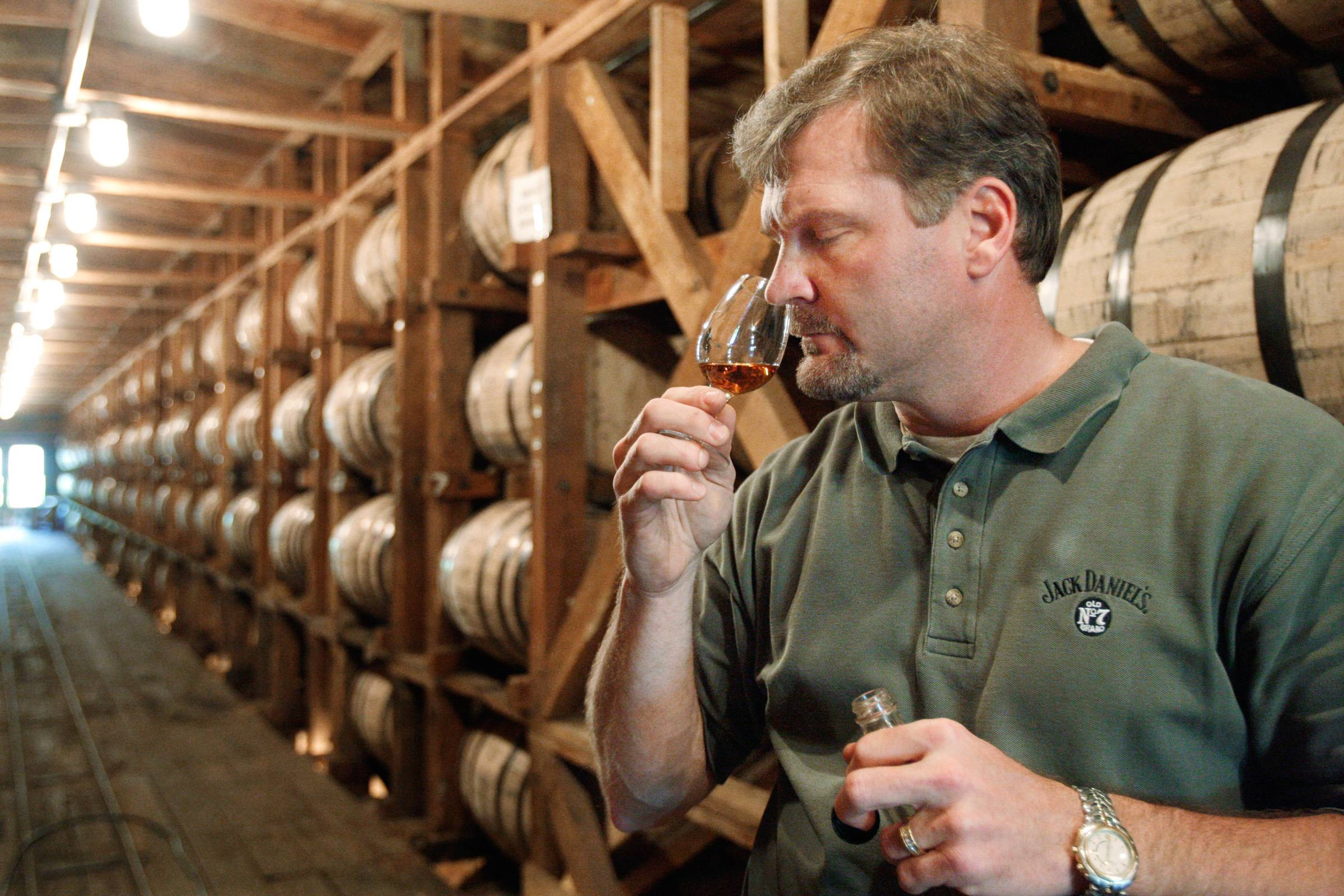 Jeff Arnett, the master distiller at the Jack Daniel Distillery in Lynchburg, Tenn., tests the aroma of whiskey at the distillery.
