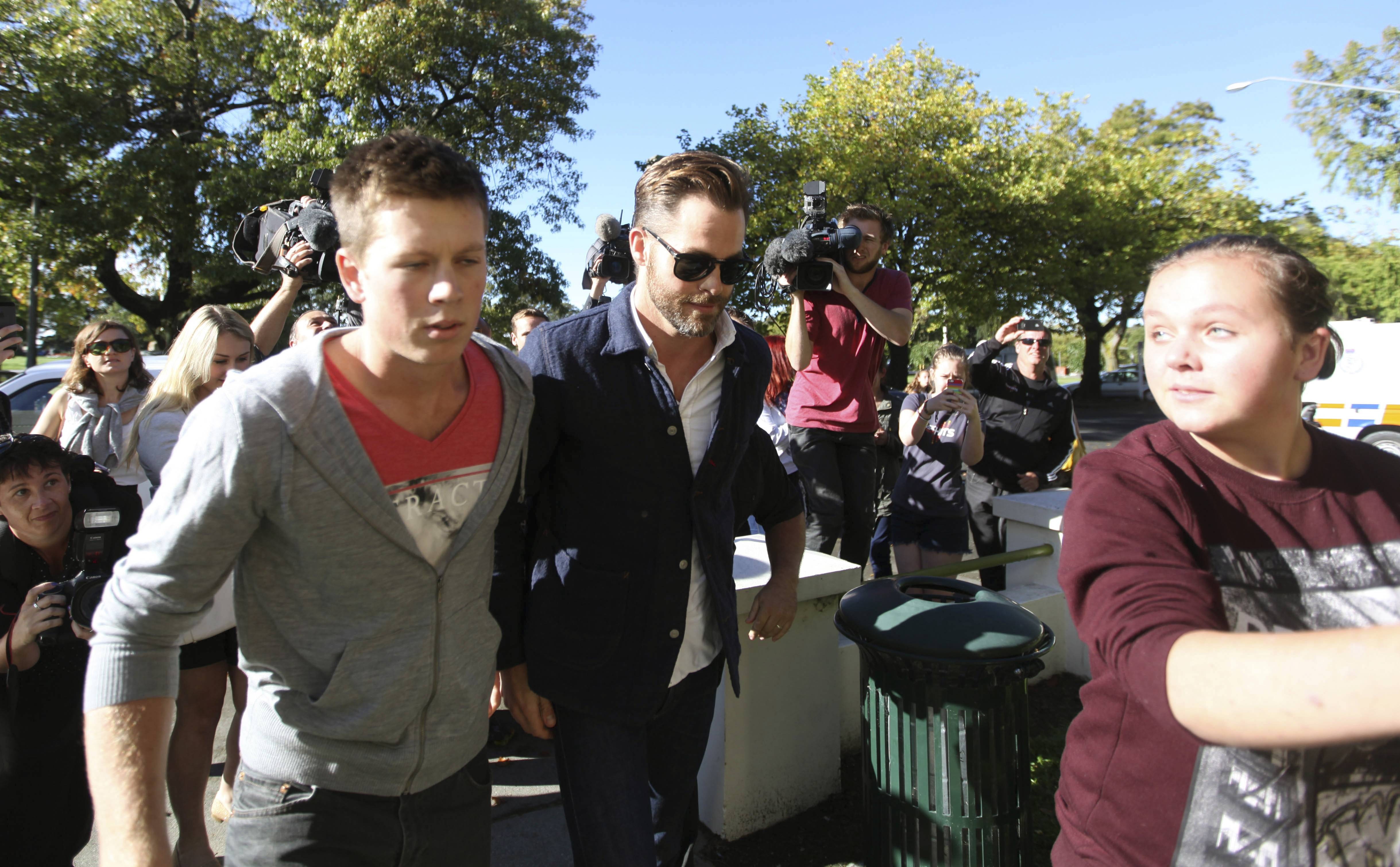 Actor Chris Pine, center, arrives at a courthouse in Ashburton, New Zealand, Monday. Pine pleaded guilty in the New Zealand court to drunken-driving charges.