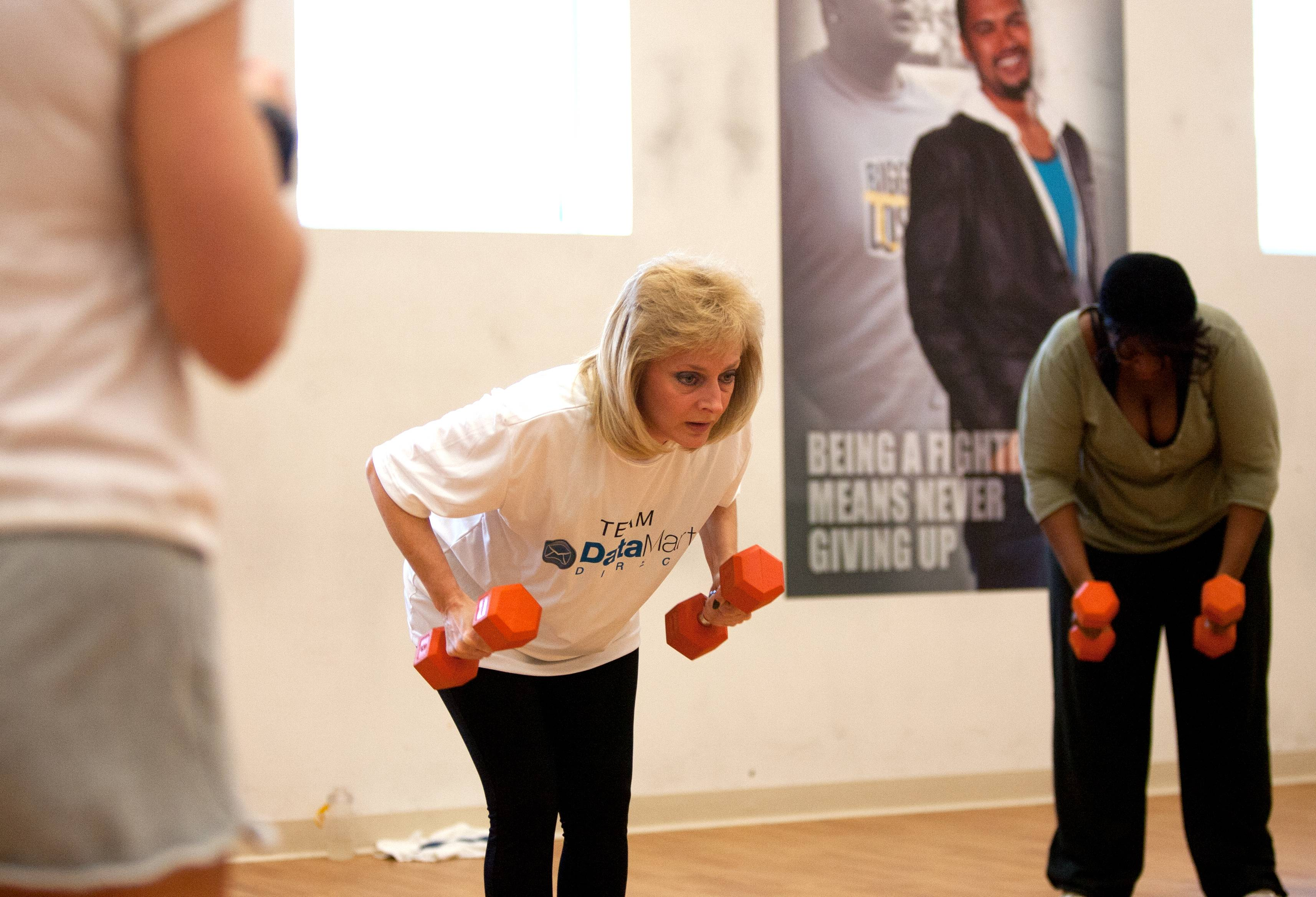 Wendy Schmidt, center, Fittest Loser Corporate Challenge team member from Team Data Mart Direct in Bloomingdale, works out under the direction of Andra Shrader, left, at the Biggest Loser Resort.