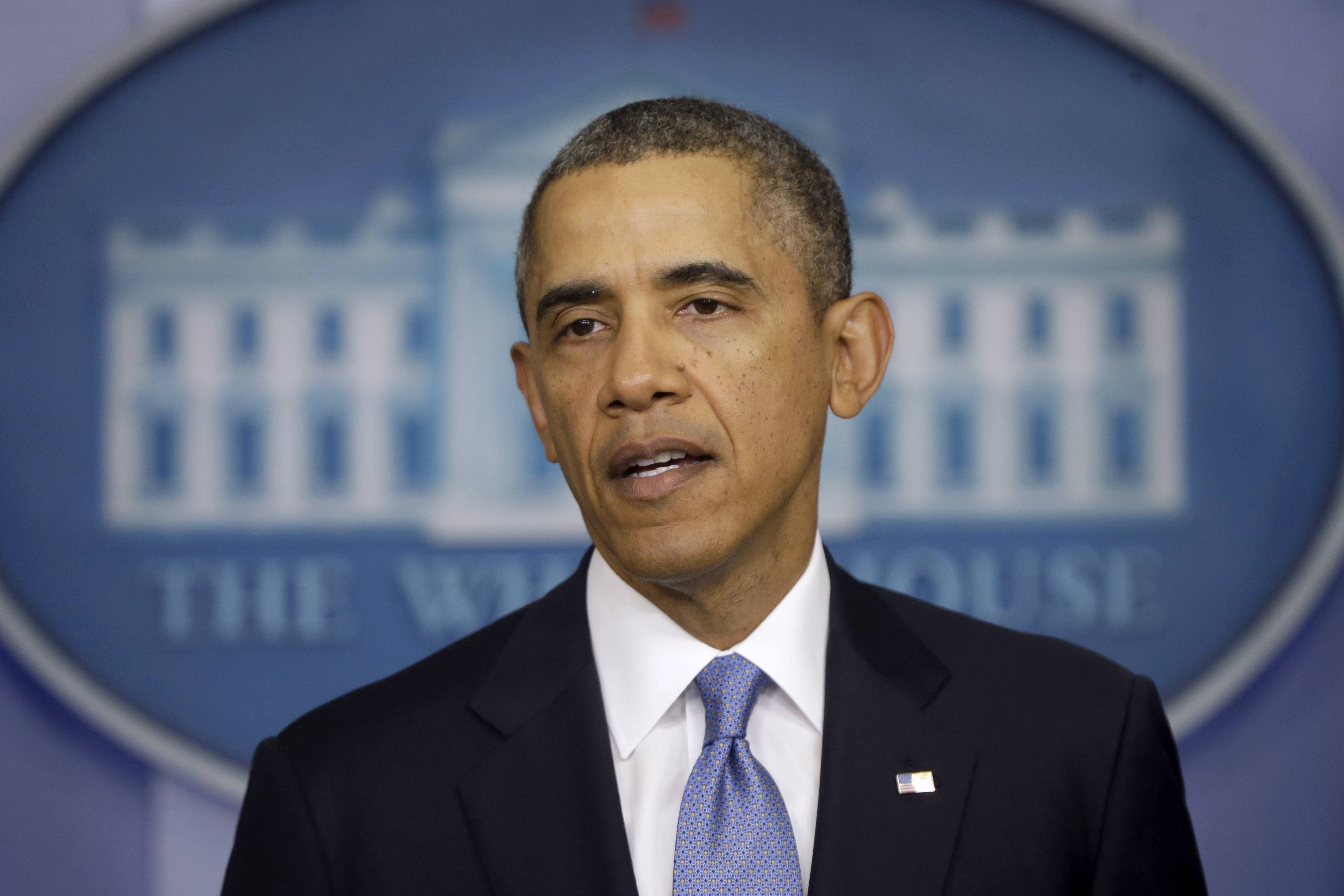 President Barack Obama speaks about Ukraine Monday in the James Brady Press Briefing Room at the White House in Washington. The president imposed sanctions against Russian officials, including advisers to President Vladimir Putin, for their support of Crimea's vote to secede from Ukraine.