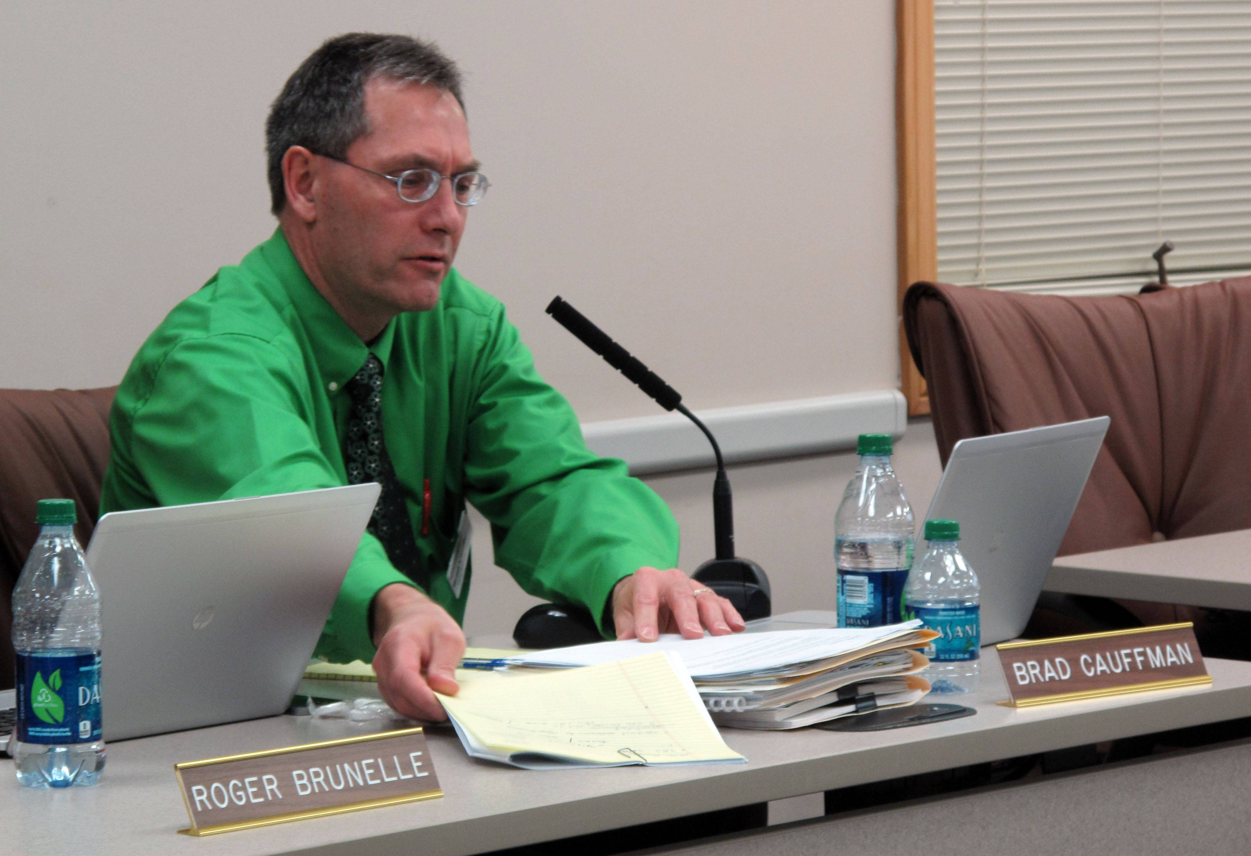Brad Cauffman, chief financial officer for Naperville Unit District 203, reviews a proposal to keep $3 million in property tax revenue and use it to help repay a loan early. The school board decided Monday night to keep the taxes in an effort to save nearly $5 million in interest payments.