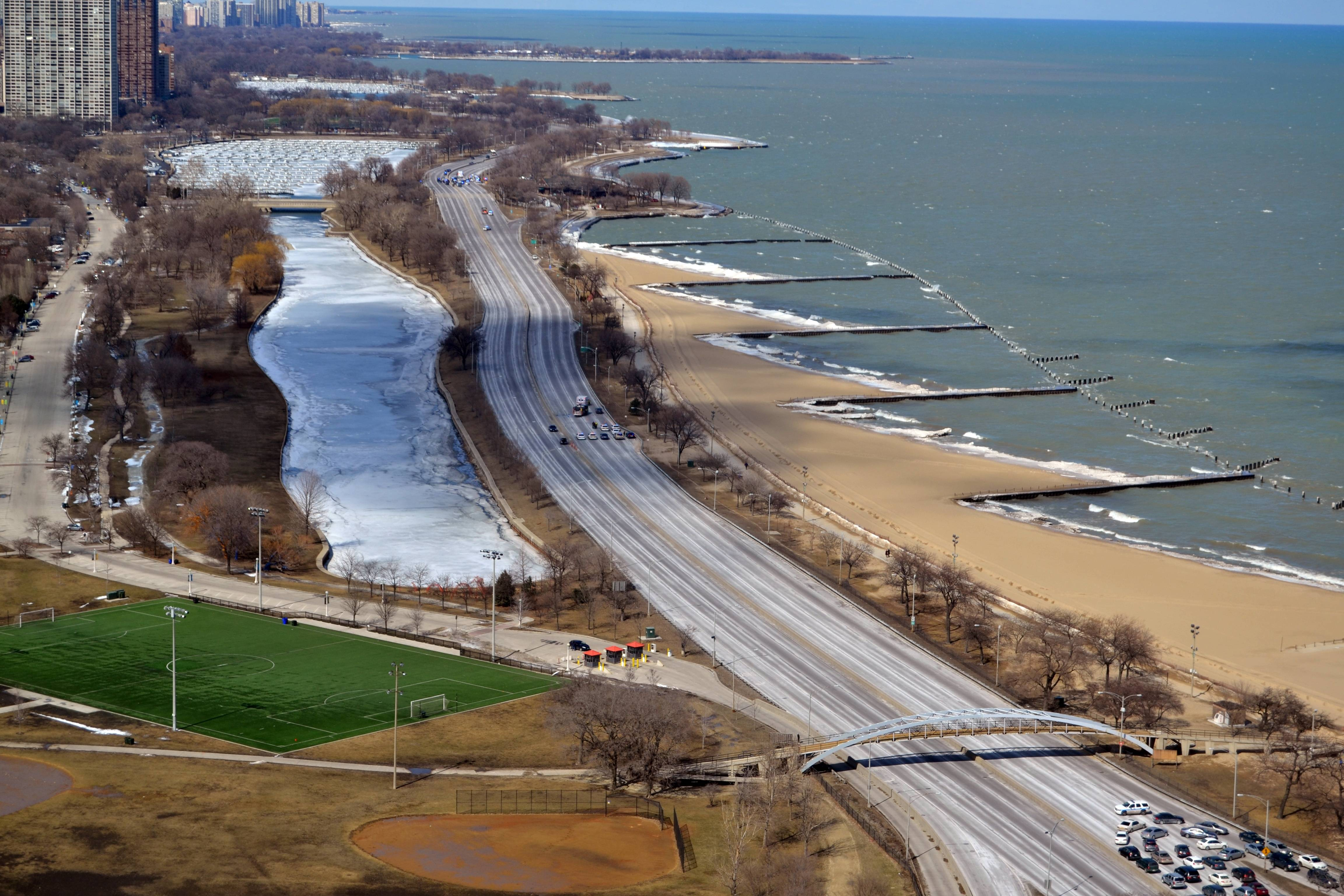 In this photo provided by Ed Bachrach, authorities surround a vehicle on Lake Shore Drive in Chicago, Sunday.