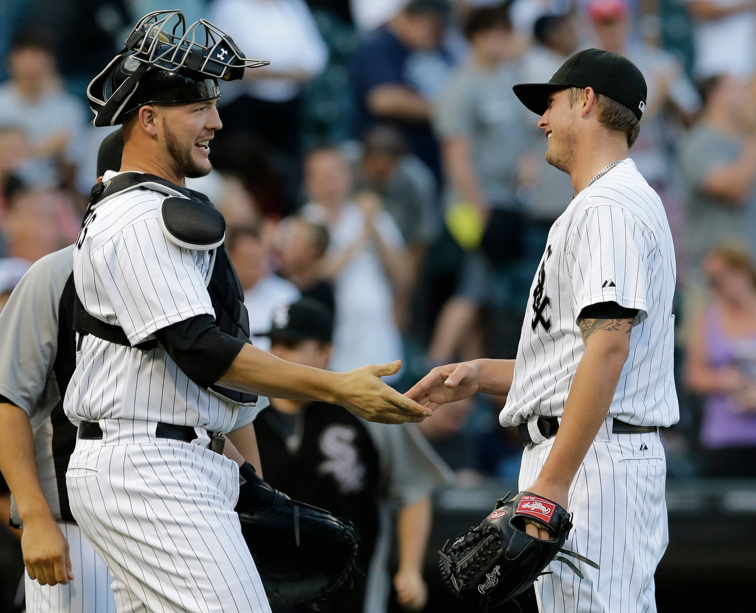 White Sox closer Addison Reed, right, celebrates with catcher Tyler Flowers after defeating the Minnesota Twins 5-4 in a baseball game in Chicago, Saturday, Aug. 10, 2013.