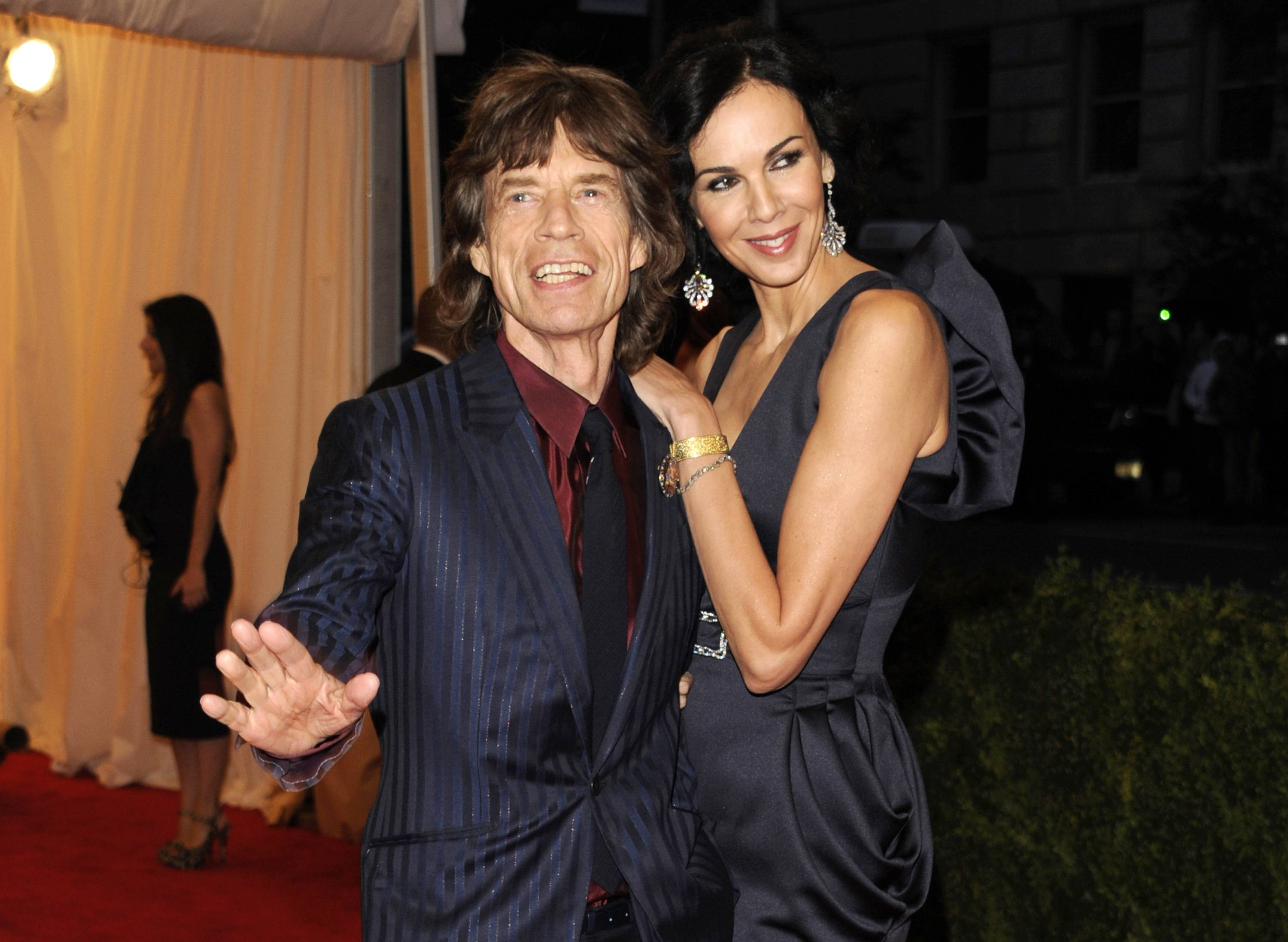Mick Jagger and L'Wren Scott are seen in May 2012. Scott, a fashion designer, was found dead Monday in Manhattan of a possible suicide.
