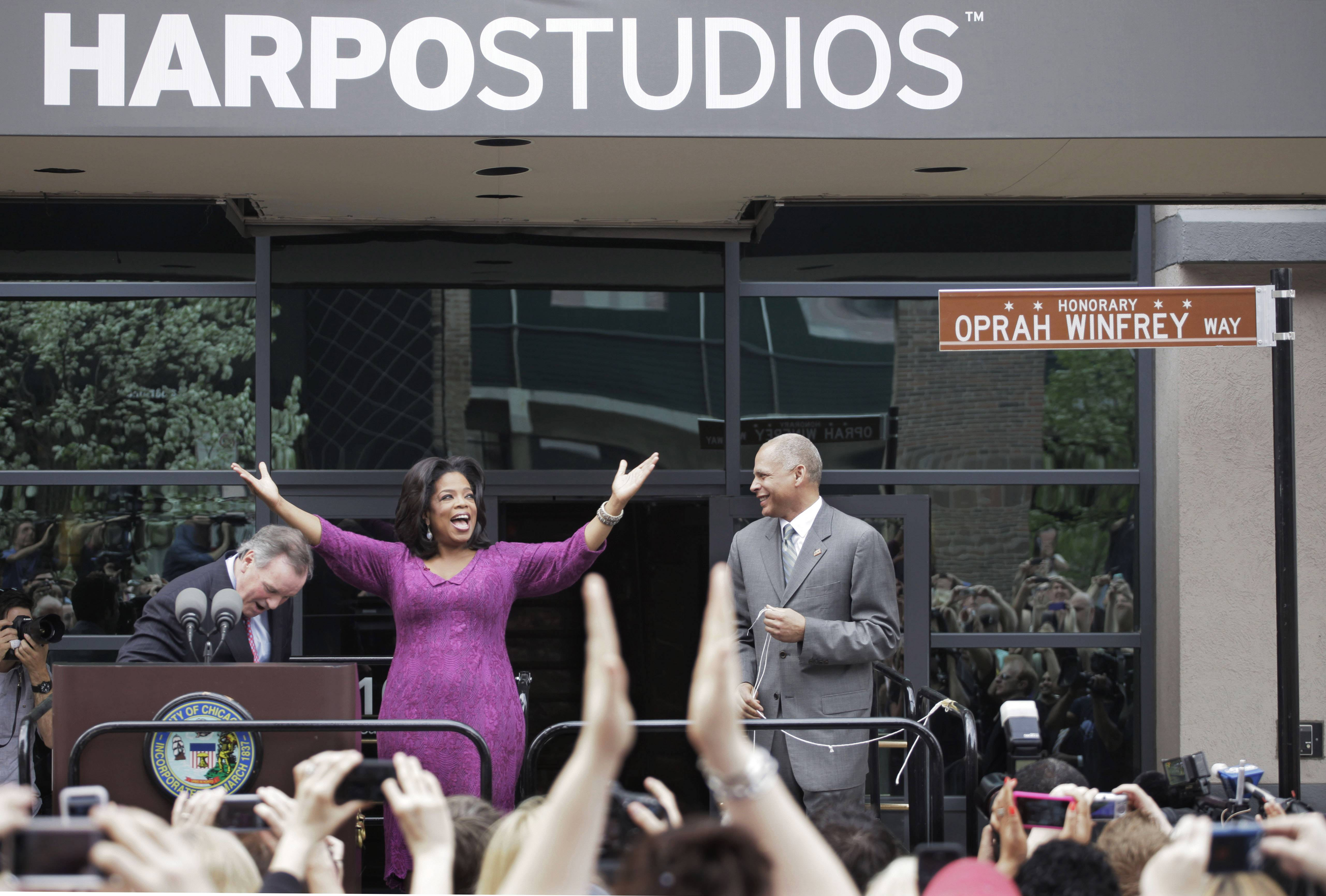 "This 2011 photo shows talk-show host Oprah Winfrey reacting after a street outside her Harpo Studios in Chicago was proclaimed ""Oprah Winfrey Way"" during a ceremony with Chicago Mayor Richard M. Daley, left, and Bobby Ware, commissioner of the Chicago Department of Transportation.  Winfrey is selling Harpo Studios in Chicago to a developer, but the studio will remain on the property for another two years."