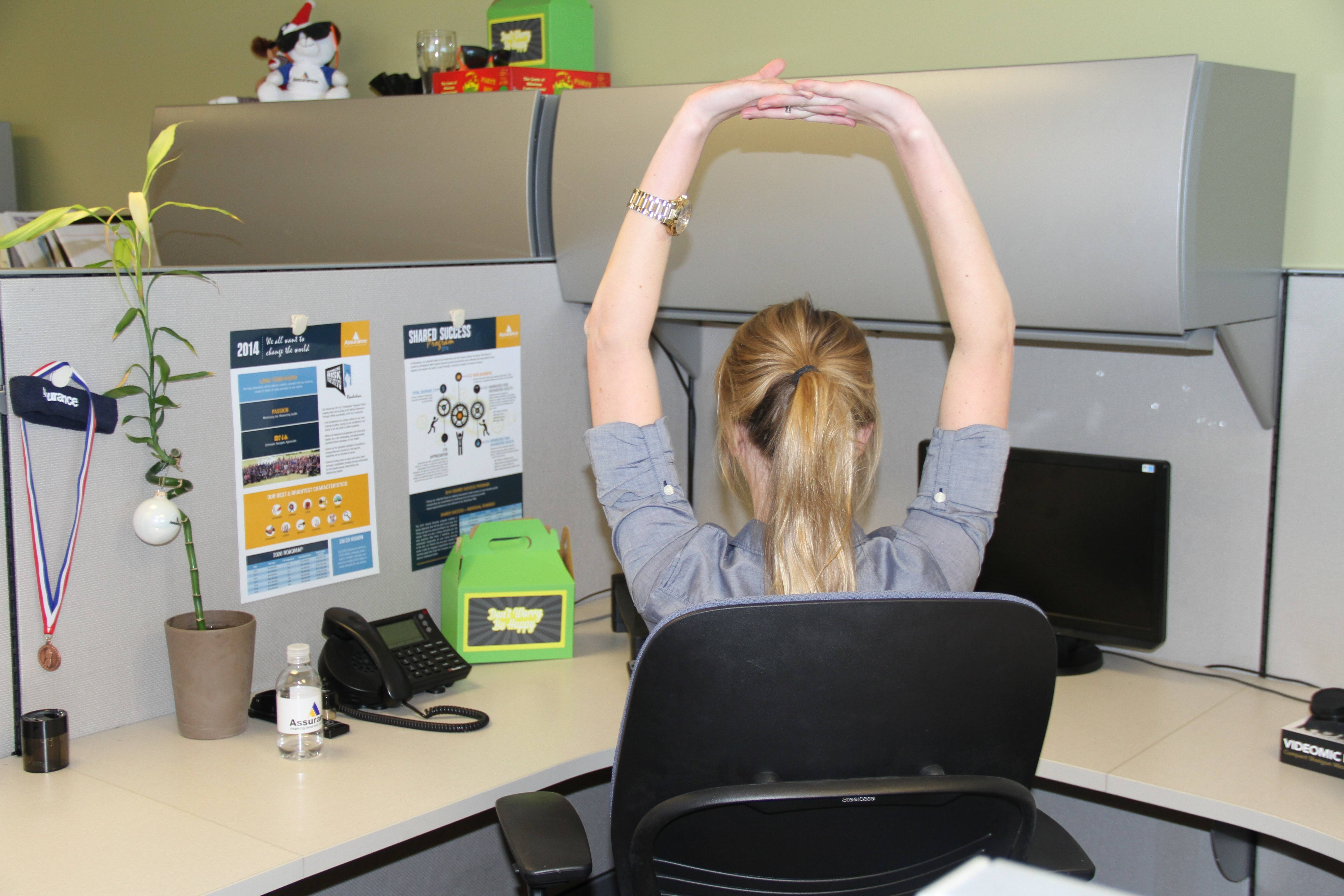 Jill Micklow takes time to stretch her body and mind at Assurance's Schaumburg office.