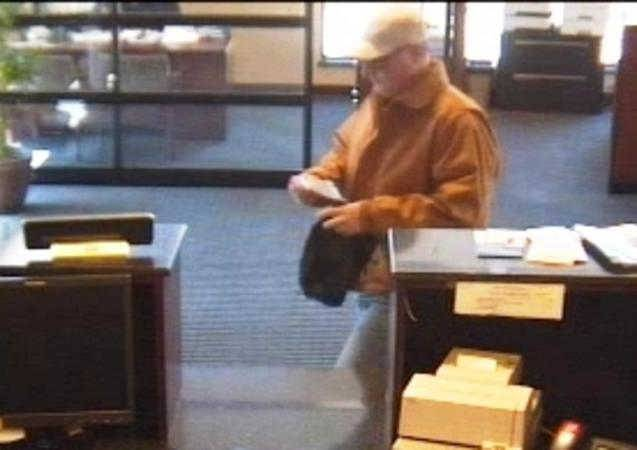 A man robs the First Merit Bank Monday afternoon in Elmhurst.