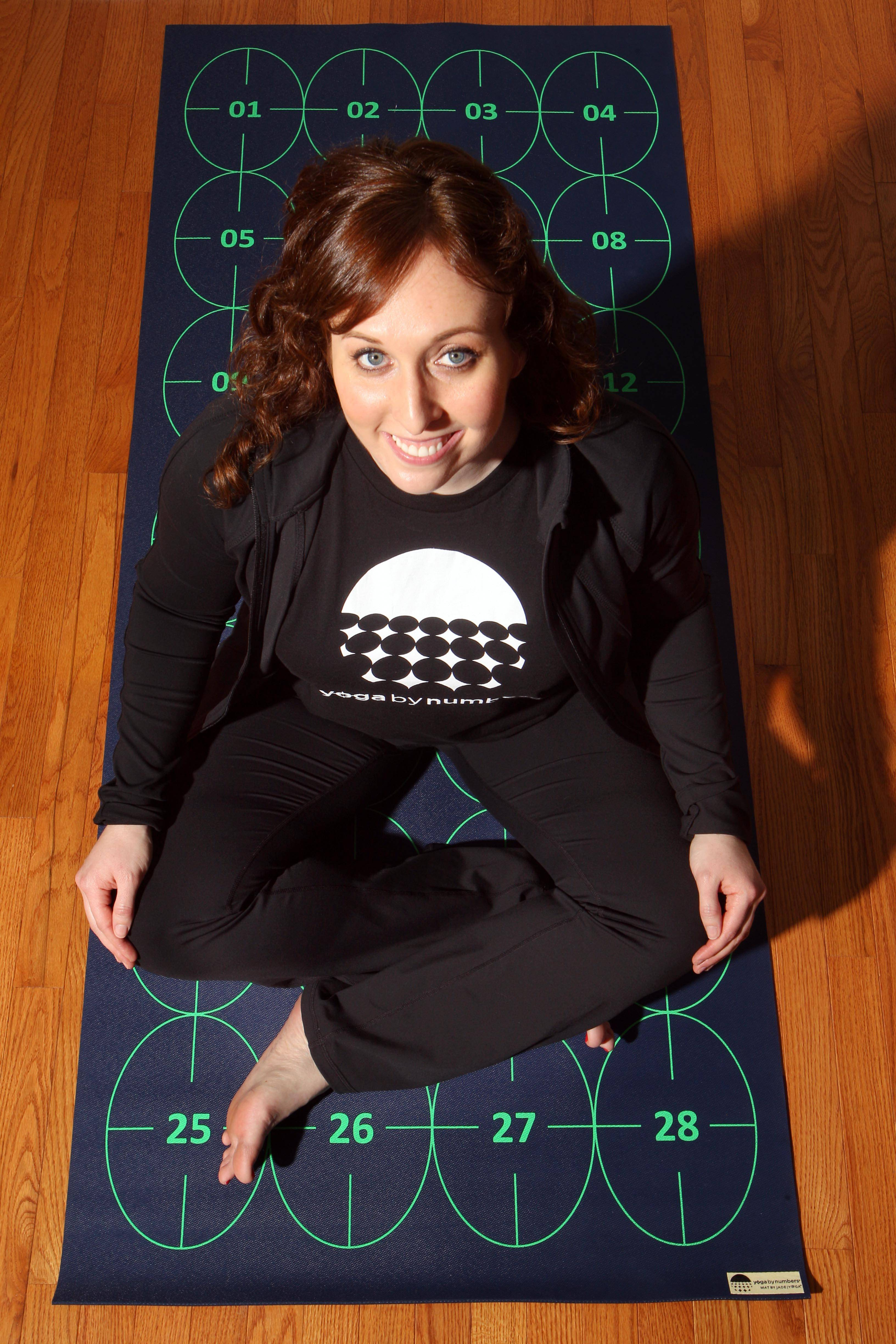 Elizabeth Morrow poses on her specially designed Yoga by Numbers mat that gives true yoga beginners a step-by-step roadmap to learn poses at their own pace.