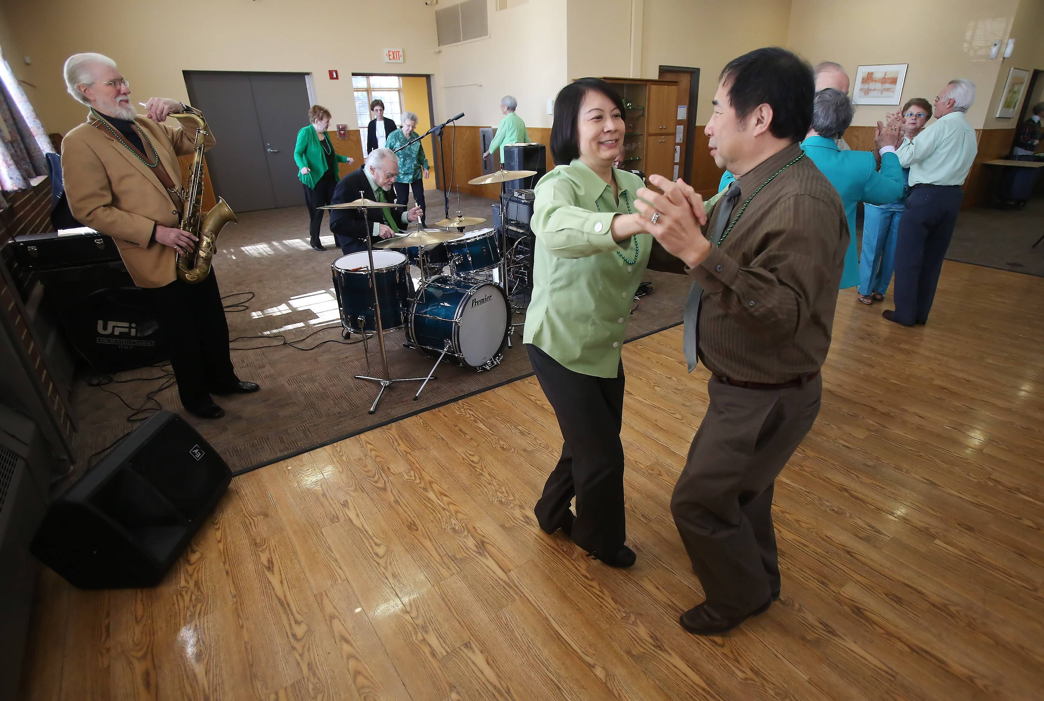 Frank and Sue Bing of Buffalo Grove dance to the music of The Ron Barron Trio during Monday's St. Patrick's Day Party hosted by the Libertyville Senior Center. The event featured an Irish lunch of corned beef and cabbage and dancing to traditional Irish music.