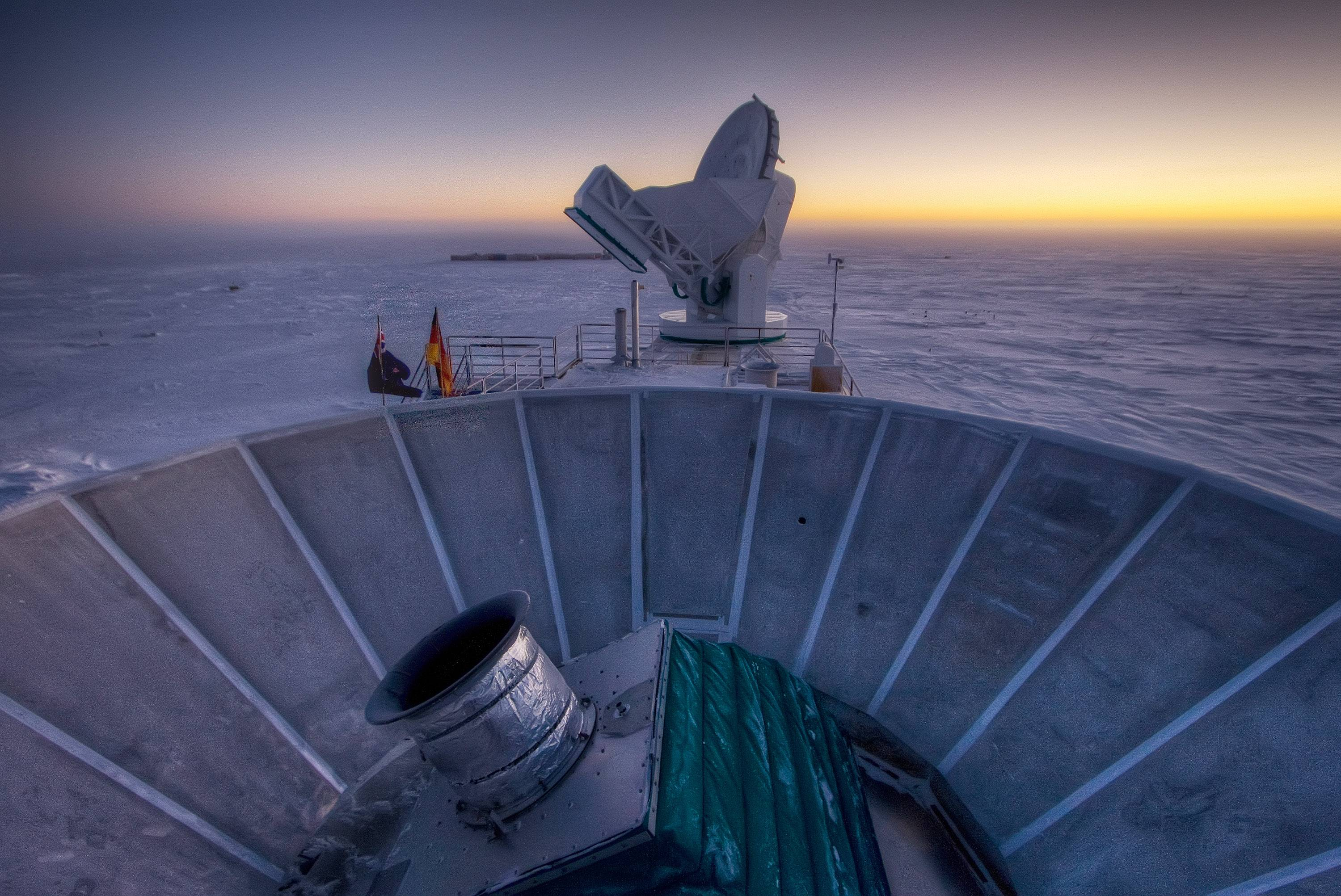 "In this 2007 photo provided by Steffen Richter, the sun sets behind the BICEP2 telescope, foreground, and the South Pole Telescope in Antarctica. In the faint glowing remains of the Big Bang, scientists found ""smoking gun"" evidence that the universe began with a split-second of astonishingly rapid growth from a seed far smaller than an atom. To find a pattern of polarization in the faint light left over from the Big Bang, astronomers scanned about 2 percent of the sky for three years with the BICEP2 at the south pole, chosen for its very dry air to aid in the observations, said the leader of the collaboration, John Kovac of Harvard."