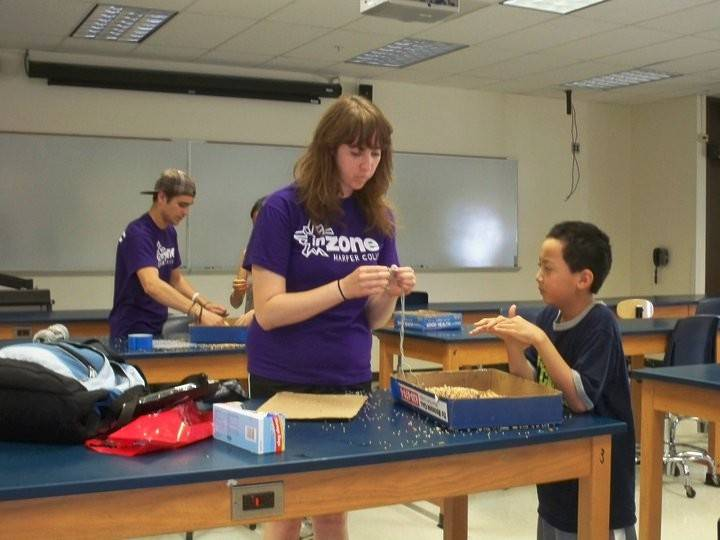 Michelle Kelley works as a camp counselor as part of Harper College's InZone program in 2011.