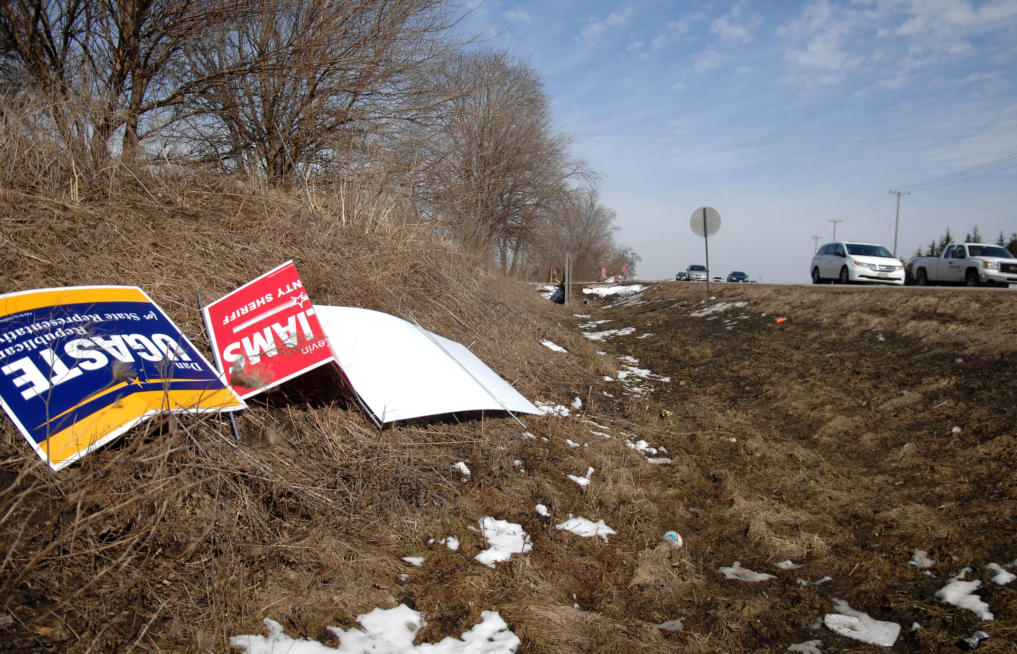 The wintry weather has made it tough to post campaign signs, with many planted in snow drifts or tossed around by high winds. The brutal winter has forced campaigns across the suburbs to adjust their tactics.