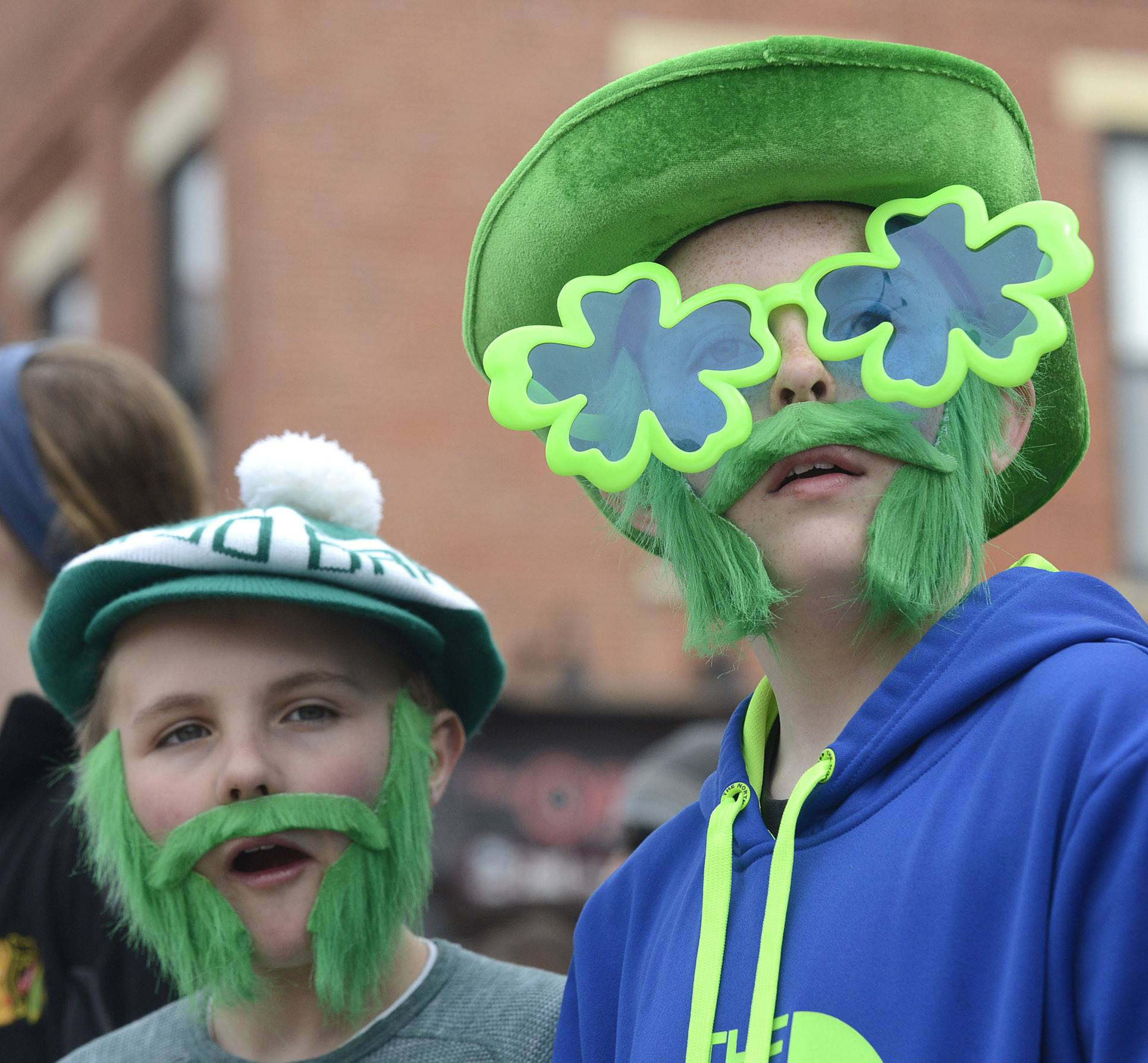 "Collin Goode, 11, left, and Sean O'Connor, 10, best friends from St. Charles, watch the St. Patrick's Day parade in St. Charles on Saturday. The duo, who say they do everything together, come every year to the parade.  ""We really enjoy being Irish,"" said Collin with a smile."