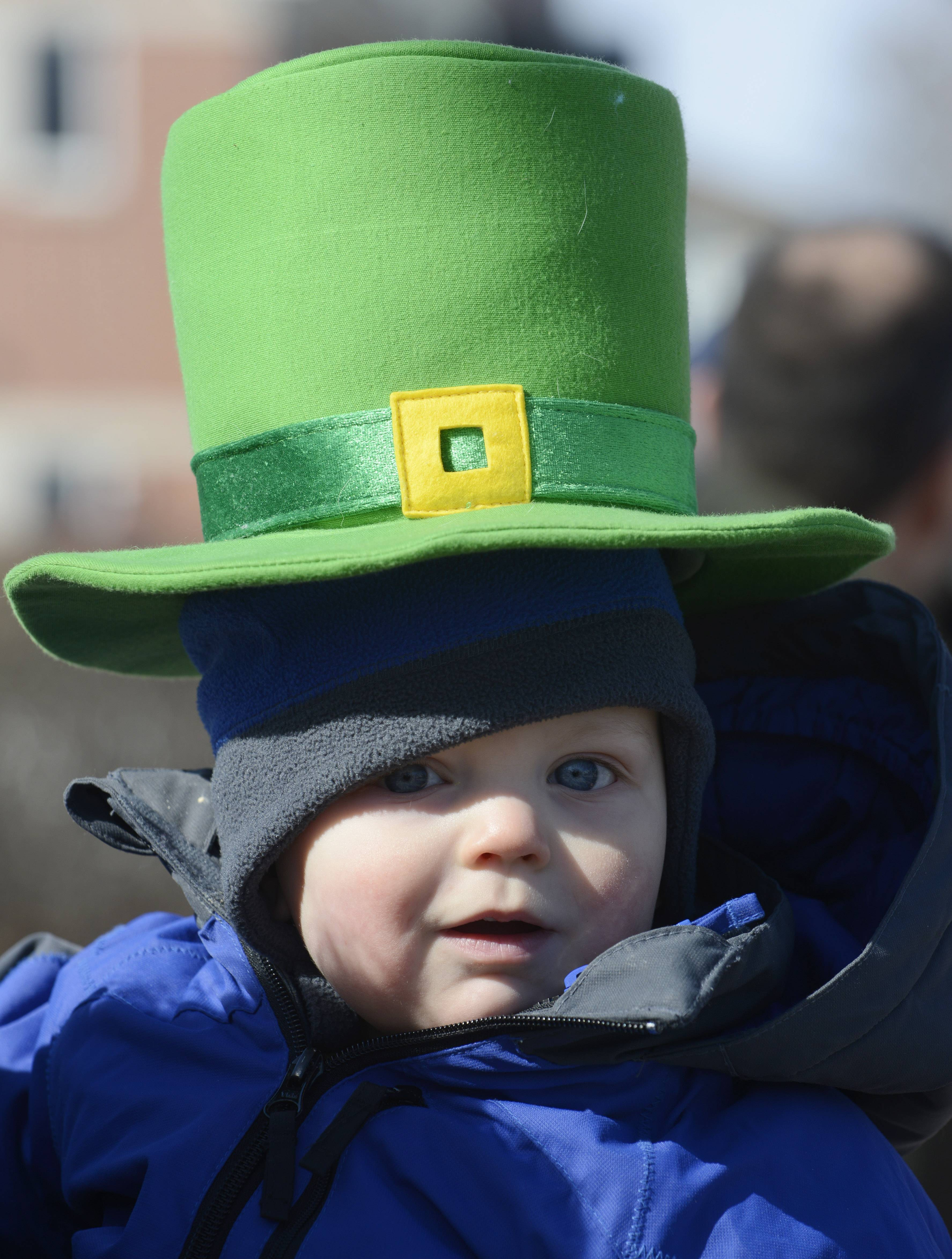 Caleb Christenson, 1, watches with delight as the Palatine St. Patrick's Day Parade approaches Saturday.