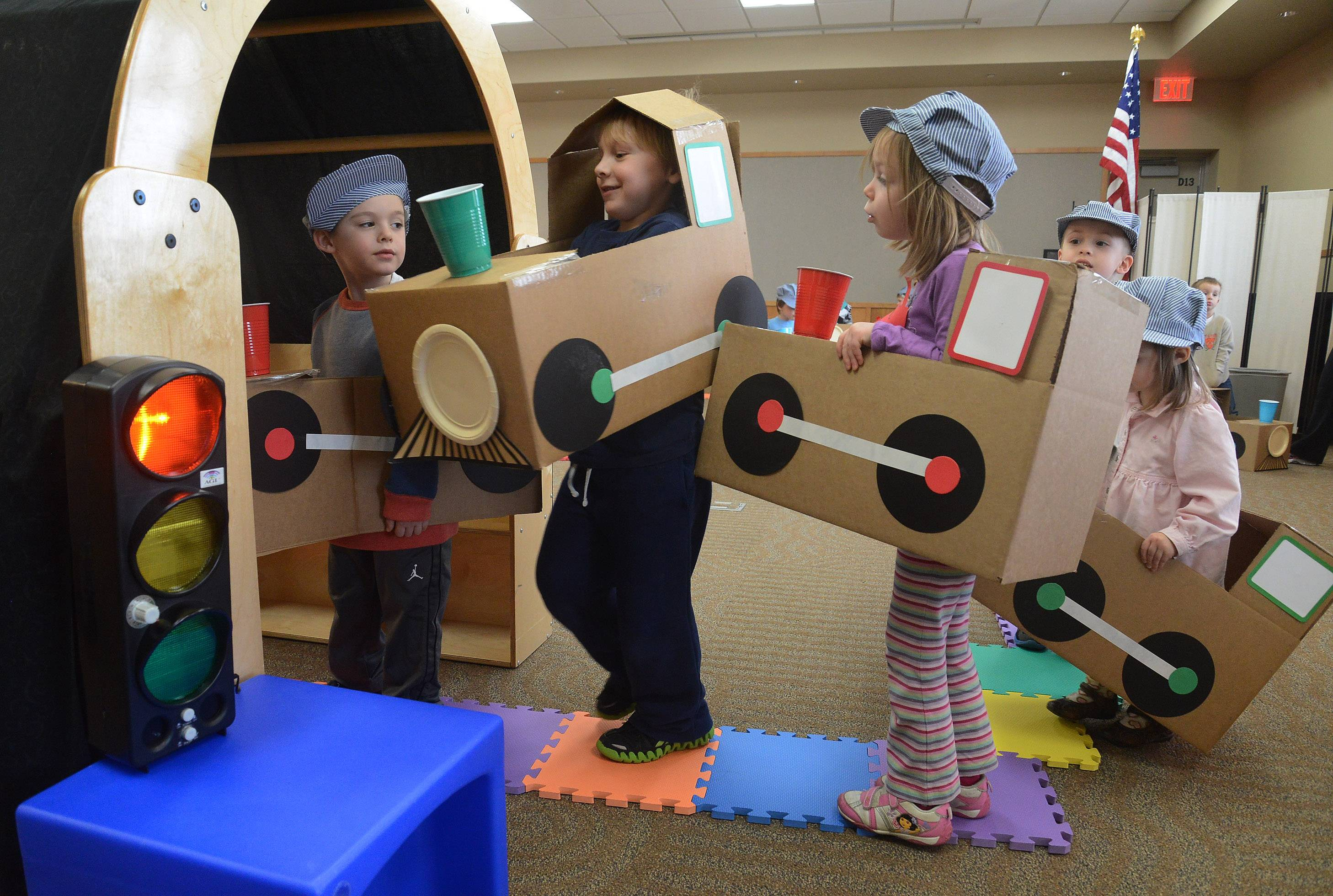 "A traffic jam ensues, led by Jace Sothen, at the tunnel during the ""Wild About Trains"" program at the Ela Area Public Library in Lake Zurich."