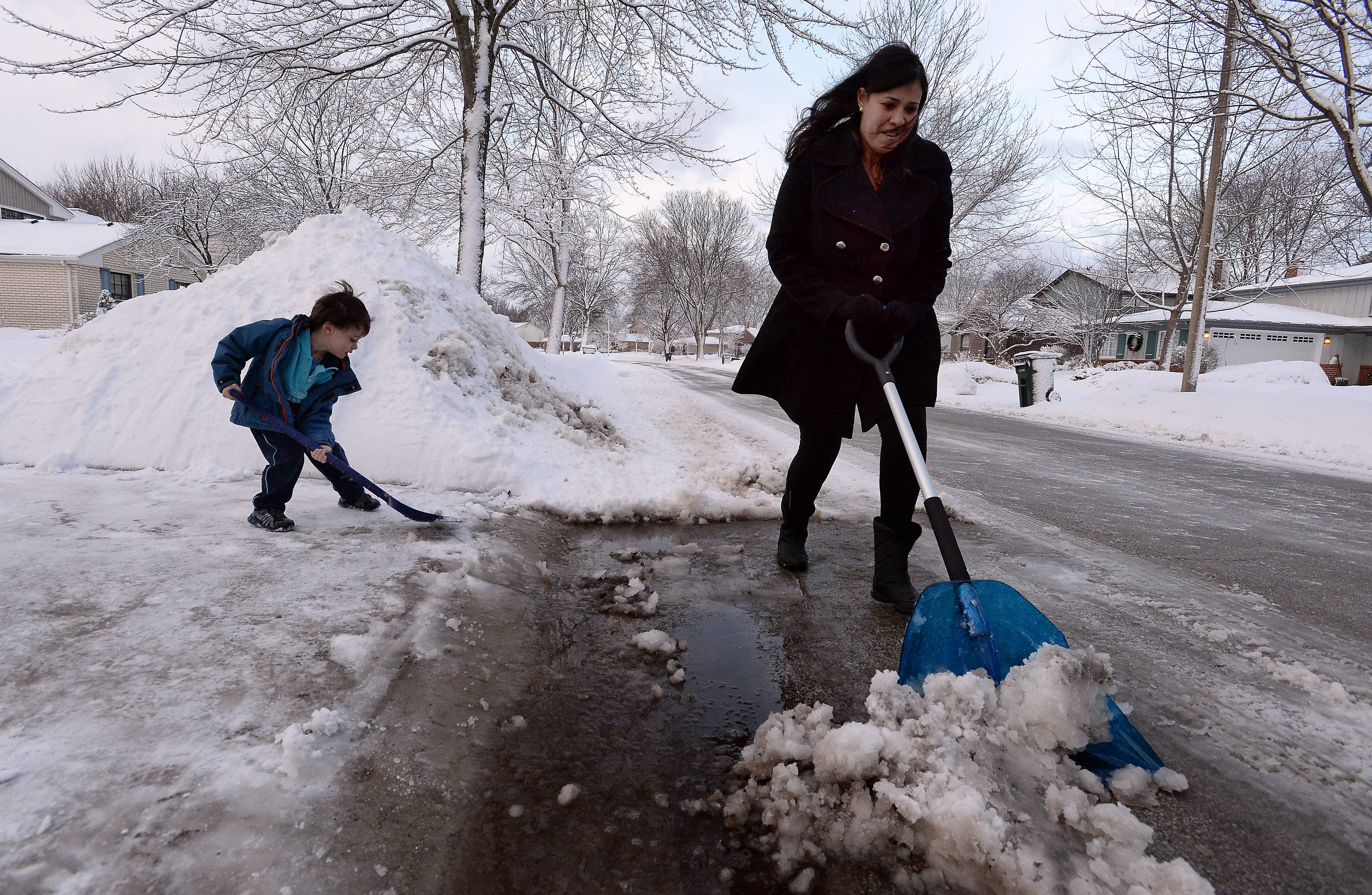 """I think we have had enough"" say Adriana Koening, of Palatine, as she and her son Heinz, 4, shovel out their driveway."