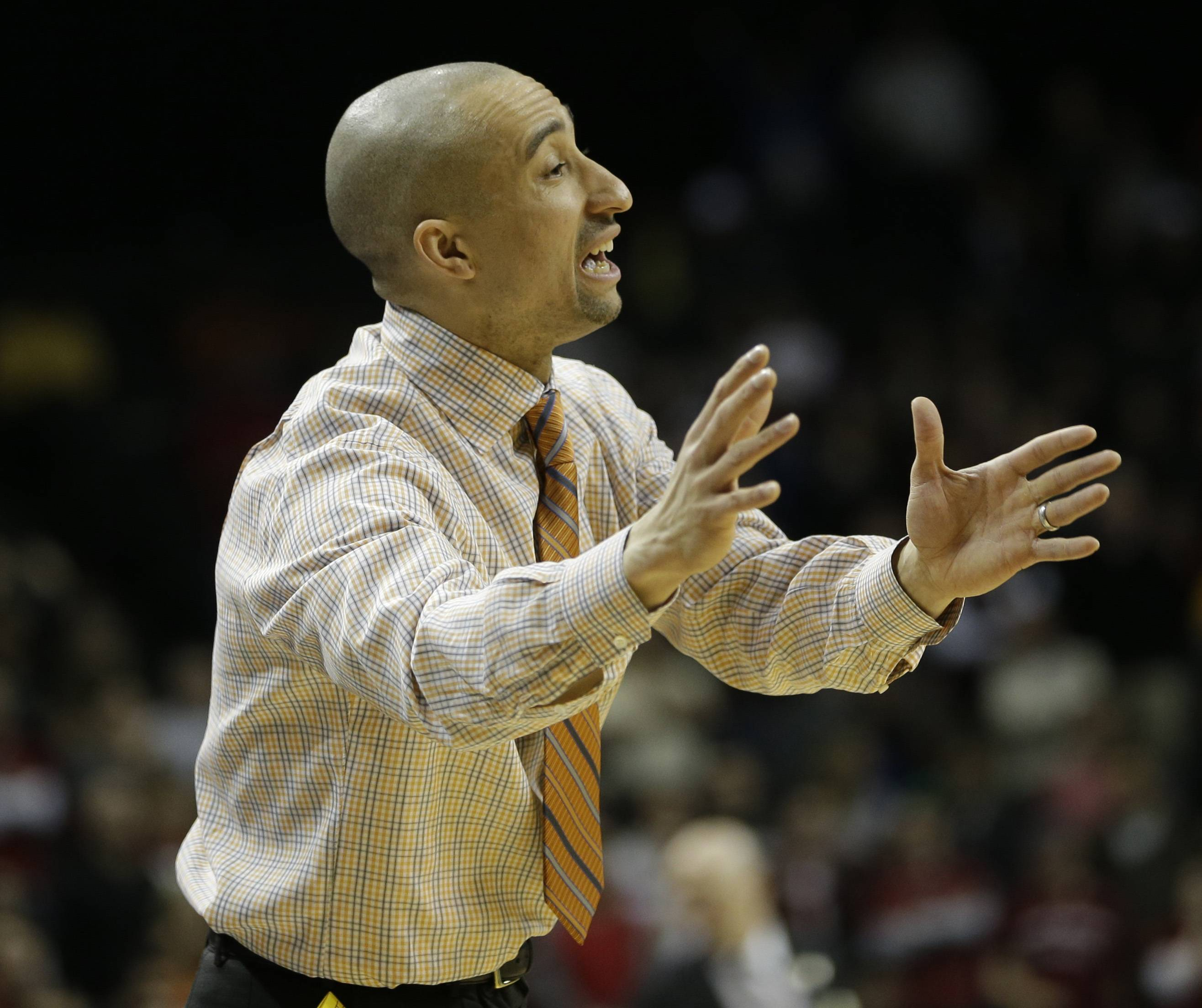 VCU head coach Shaka Smart talks to his team Sunday during the championship game of the Atlantic 10 Conference tournament at the Barclays Center in New York.