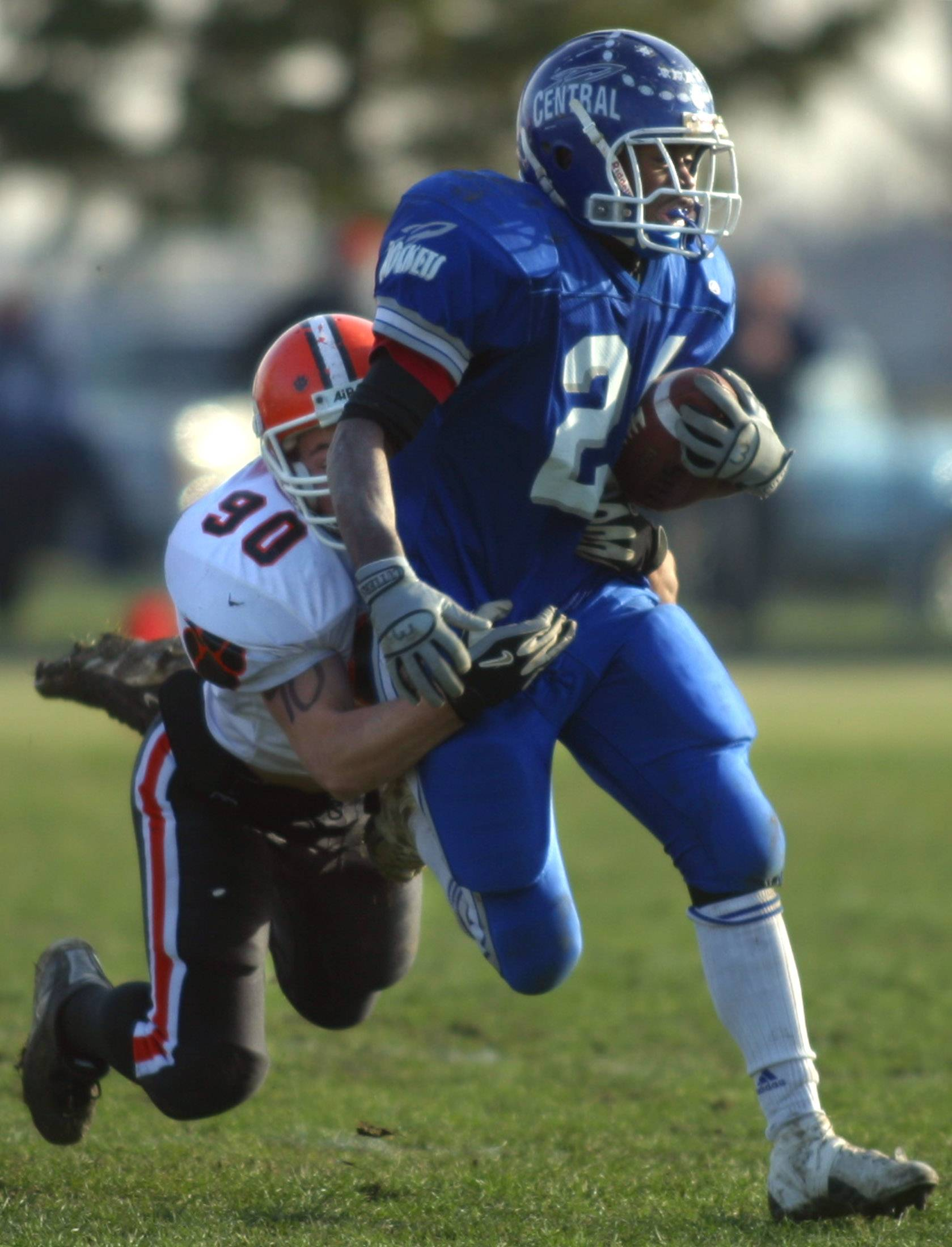 Burlington Central graduate Chris Wesson picks up yardage against Byron during a 2003 playoff team. That Rockets' team, which advanced to the Class 4A state quarterfinals and finished 11-1, will be inducted into the school's Athletic Hall of Fame on April 13.