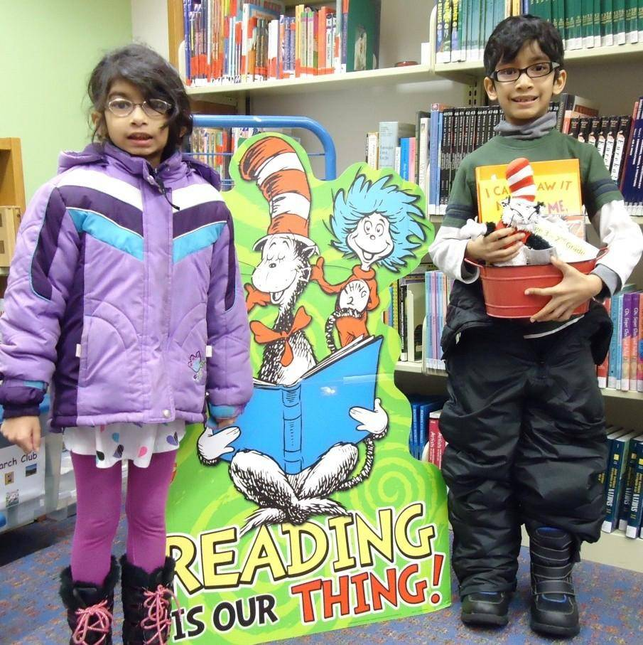 Emma Hasan, left, poses with her brother, Raiyan Hasan, one of the lucky Winter Reading Club raffle prize winners at the Bartlett Public Library.