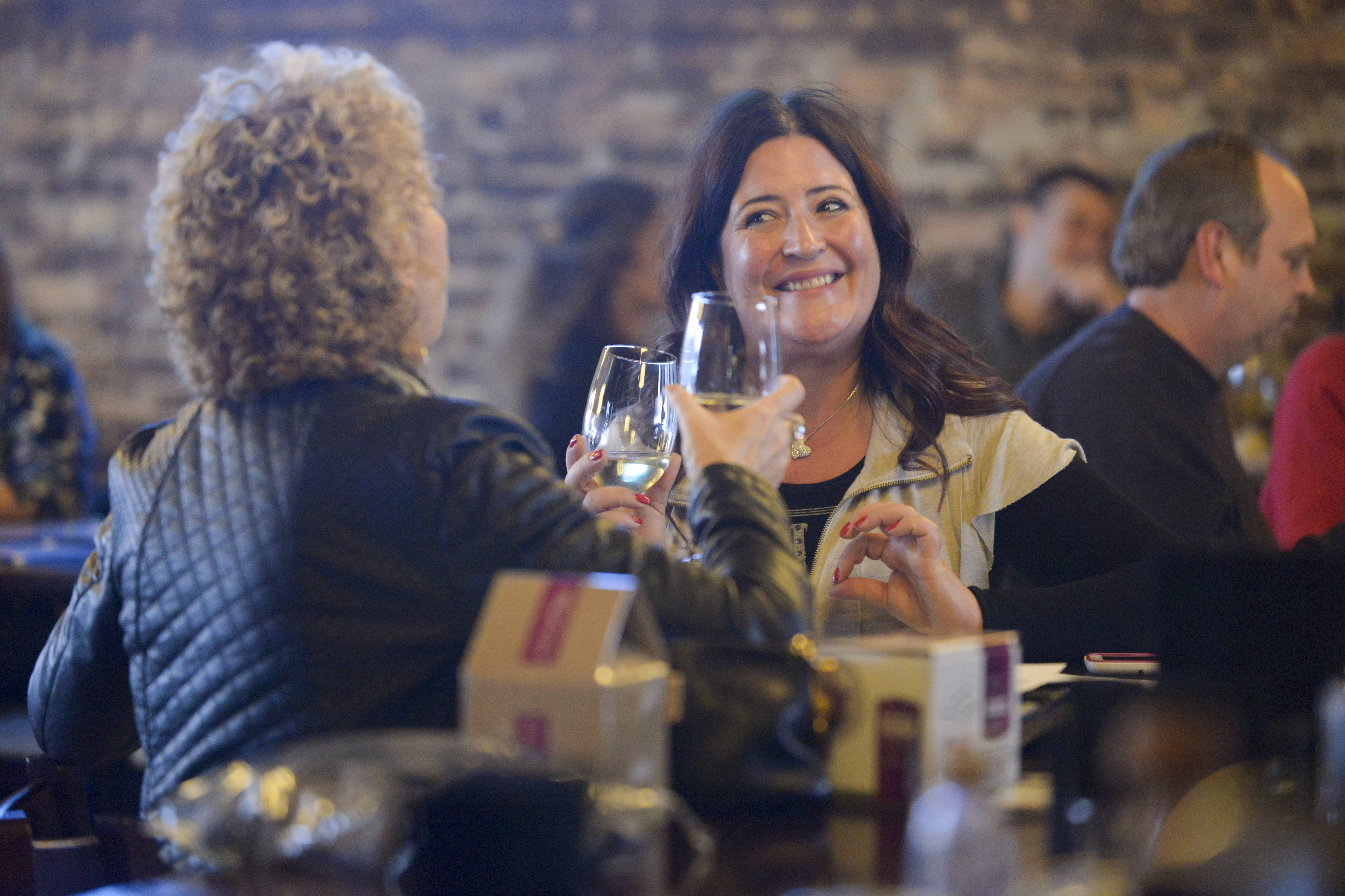 Kathy Labbe, left, of Elgin and Toni Ballentine of Roselle enjoy glasses of wine at the 1913 Restaurant and Wine Bar in Roselle.