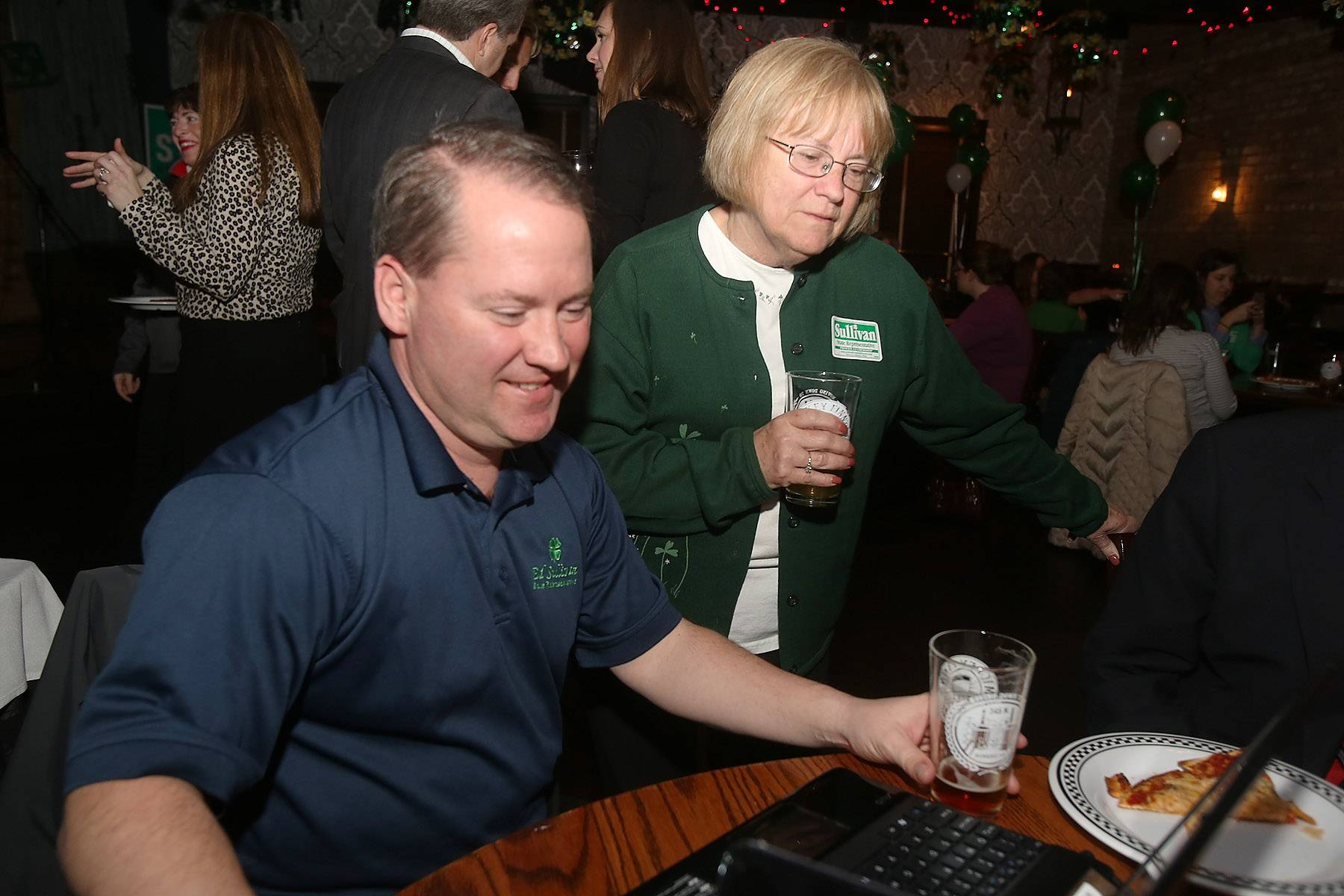 State Rep. Ed Sullivan Jr. and his mother, Barbara, check election results from the 51st House District primary Tuesday night at Mickey Finn's in Libertyville.