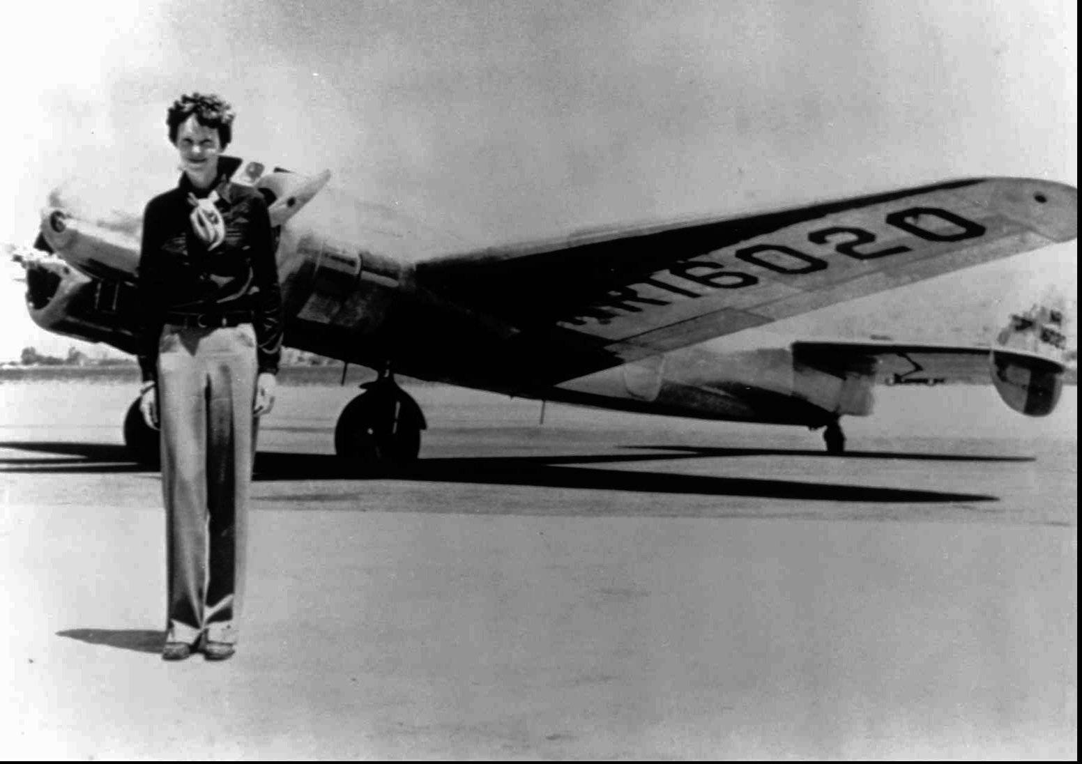 Amelia Earhart stands next to a Lockheed Electra 10E before her last flight in 1937 from Oakland, Calif., bound for Honolulu on the first leg of her record-setting attempt to circumnavigate the world westward along the Equator. Earhart's disappearance in 1937 is among aviation's most enduring mysteries.