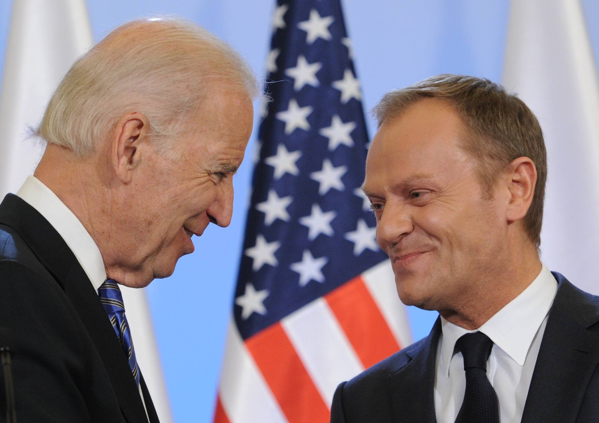 U.S. Vice President Joe Biden, left, and Polish Prime Minister Donald Tusk met for talks in Warsaw Tuesday, a few hours after Russian President Vladimir Putin approved a draft bill for the annexation of Crimea.