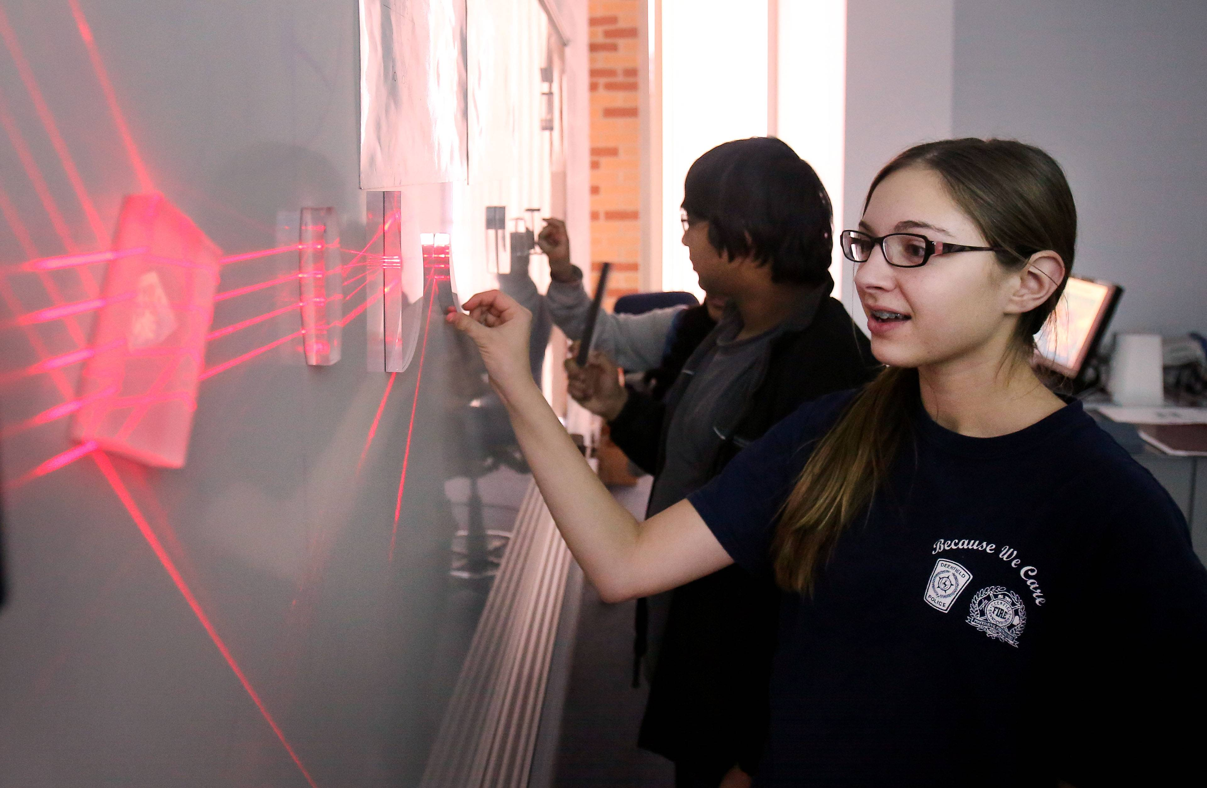 Samantha Bednarz uses optics to refract laser beams at the technology building at the College of Lake County. Twenty-three eighth-graders from Woodland, Viking and River Trail schools participated in a Laser Photonics class as part of a program called Taste of College.