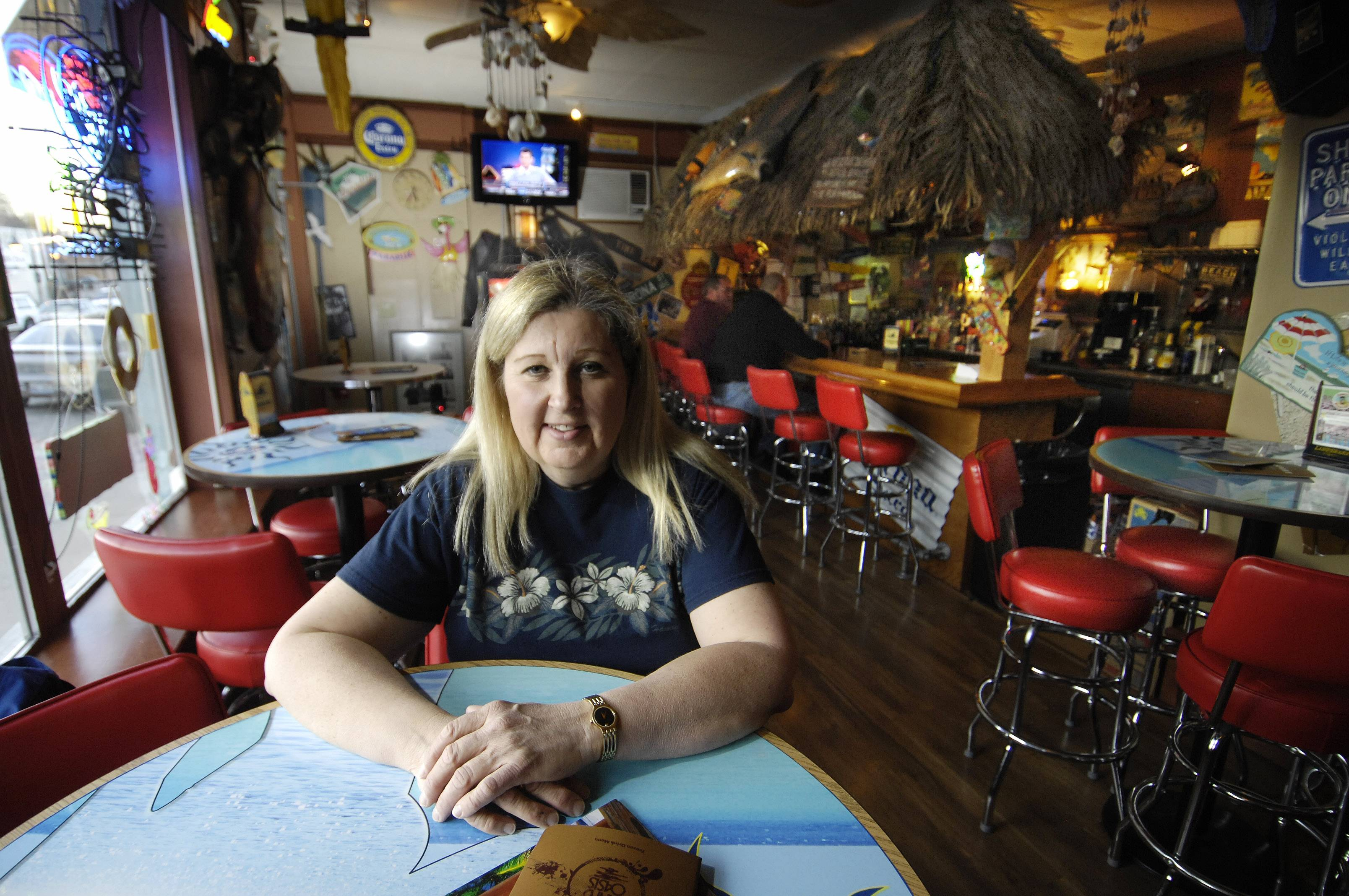 Dawn Humer of Dawn's Beach Hut in St. Charles told aldermen Monday night their new liquor laws are unfair to her small business, which has a clean record of no police calls or license violations.