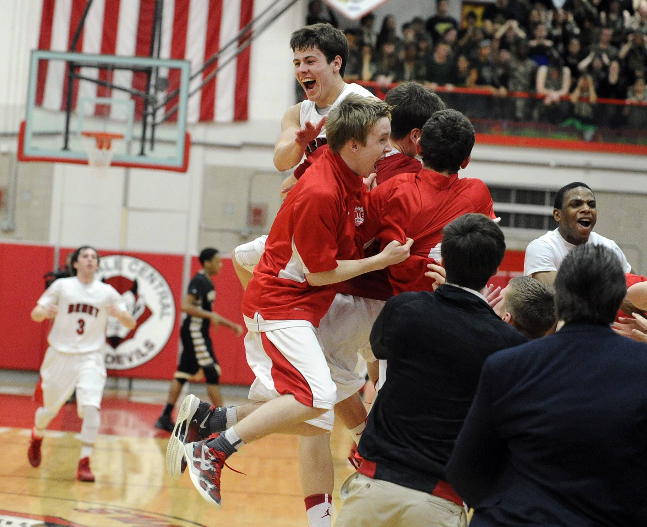 Benet's Liam Nelligan celebrates with his teammates after the Redwings beat Glenbard North in the Hinsdale Central supersectional on Tuesday.