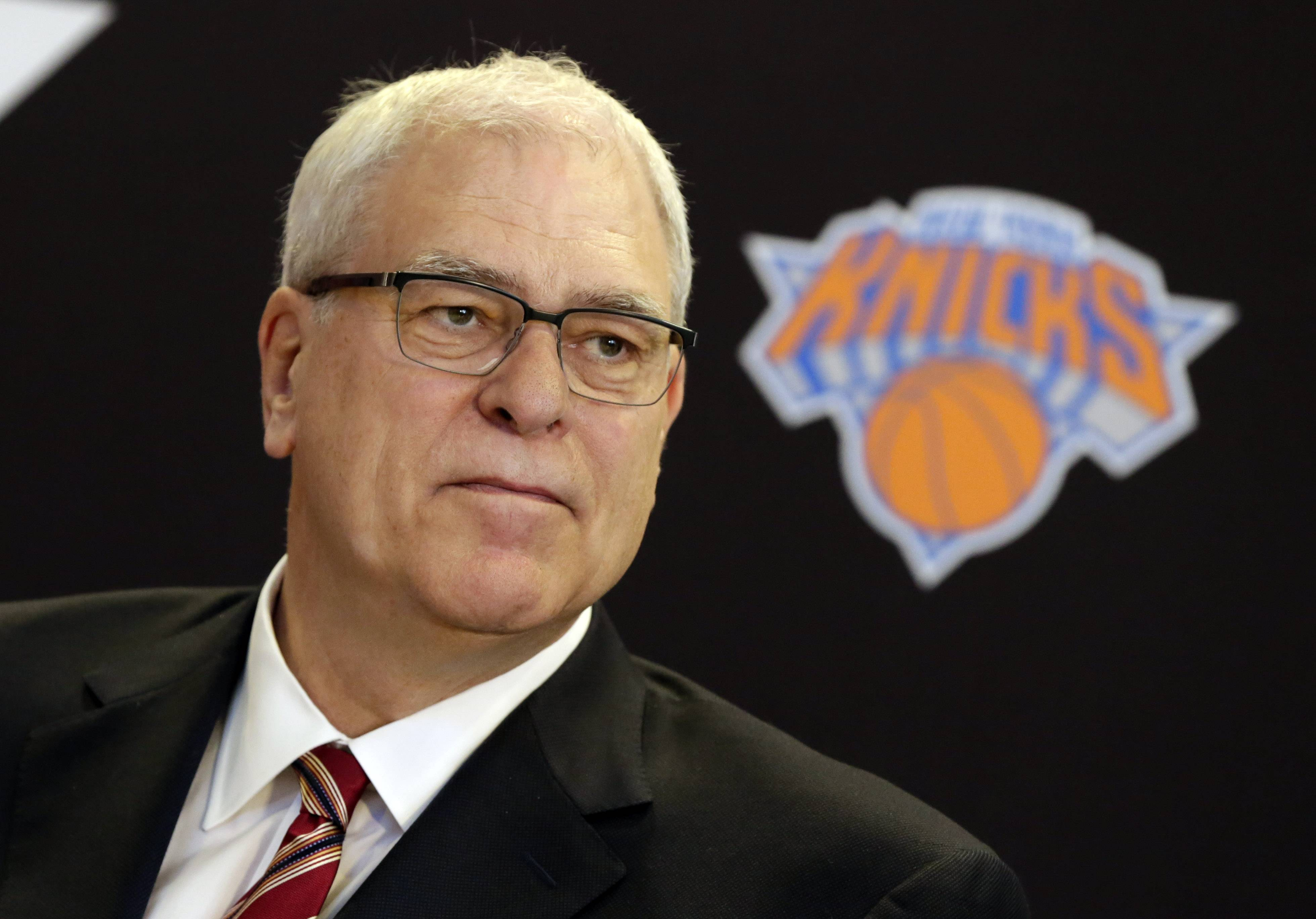 New York Knicks new team president Phil Jackson listens to a question during a news conference Tuesday at Madison Square Garden.