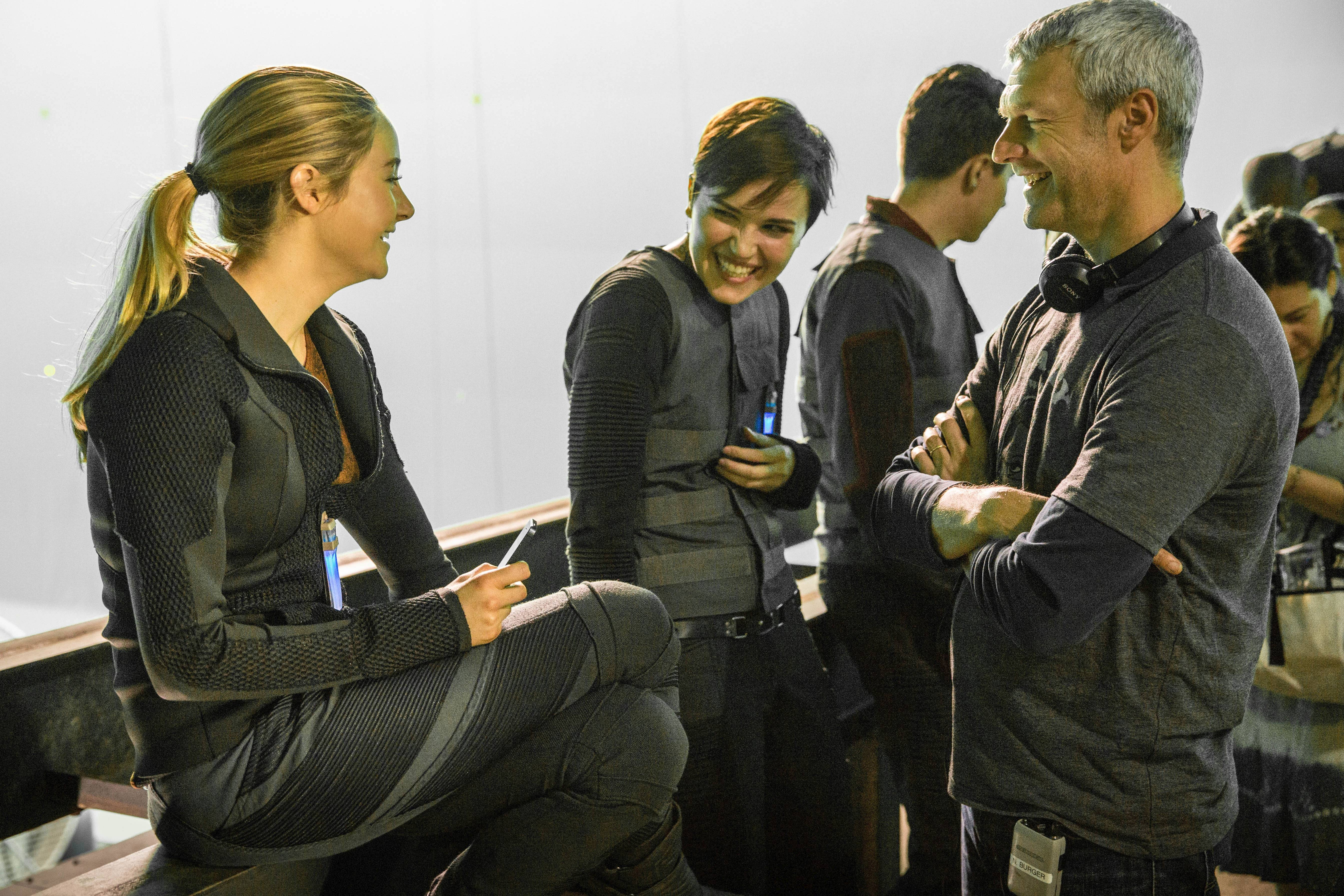 "Barrington native and novelist Veronica Roth, center, enjoys a moment on the set of the movie ""Divergent"" with star Shailene Woodley, left, and director Neil Burger. The author had a cameo."