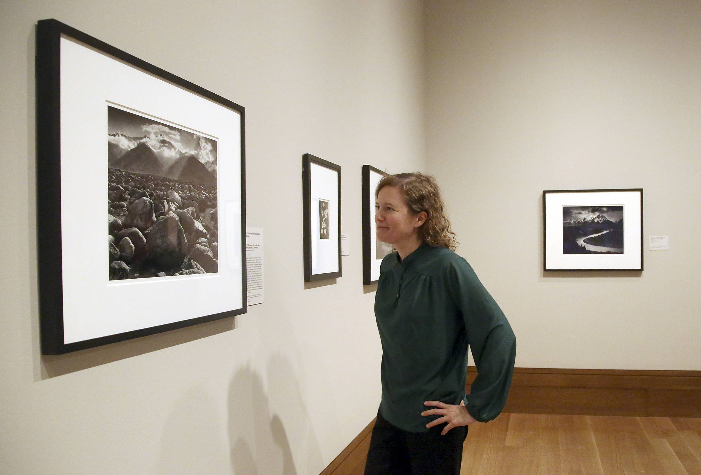 "Karen Hellman, Assistant Curator Department of Photographs at the J. Paul Getty Museum in Los Angeles, examines the new photo exhibit ""In Focus: Ansel Adams."" The exhibit opens Tuesday."