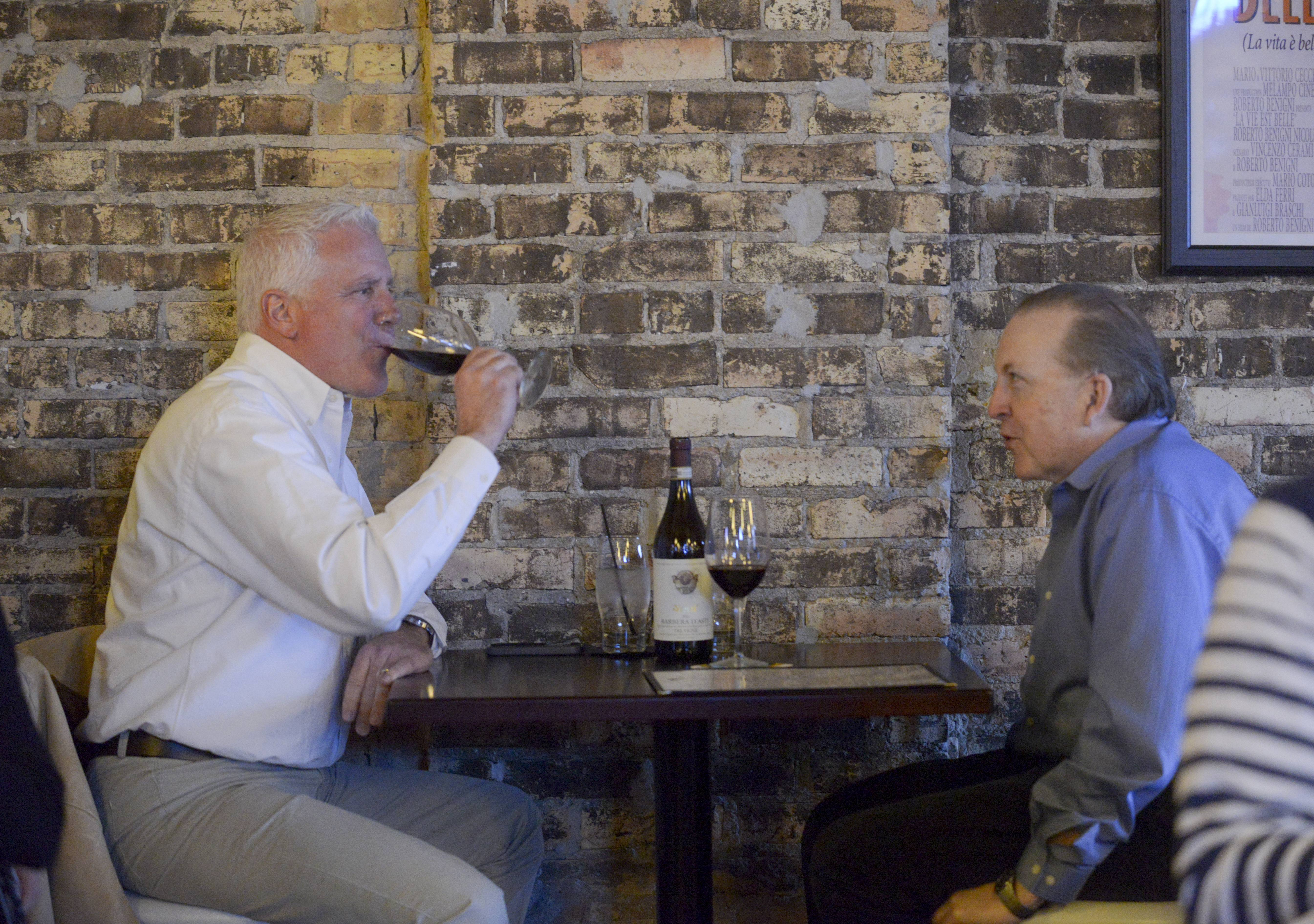 John DiBuono, left, of Elgin and Ed Culleeney of Palatine talk over glasses of wine at 1913 Restaurant and Wine Bar in Roselle.