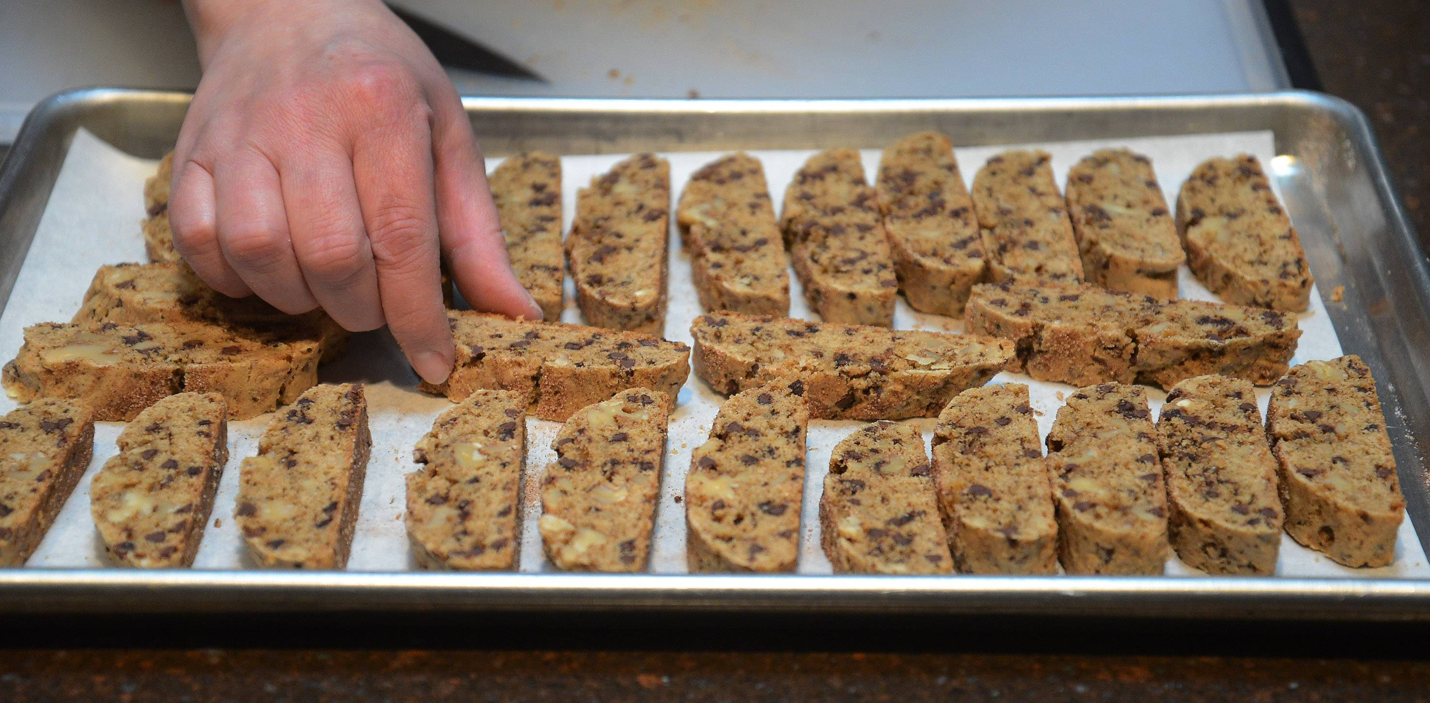 Marie DeMar gives her sliced chocolate chip and walnut biscotti a second round in the oven to make them crisp and ready for dunking.