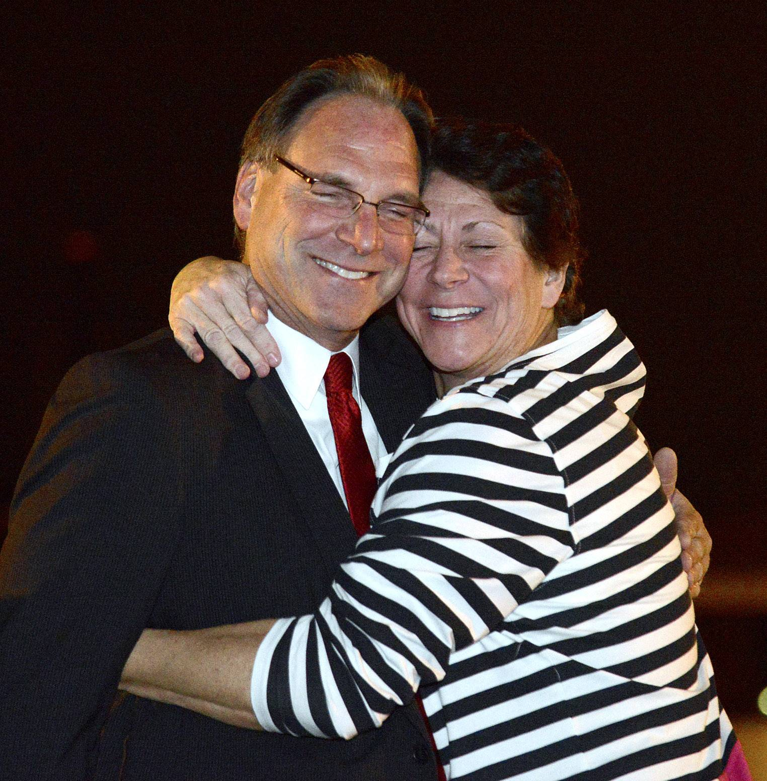 Don Kramer is embraced by his sister, Denise Bumbar, of Batavia, at his Election Night party Tuesday in Geneva. Kramer beat Kevin Williams to earn the GOP nod for Kane County sheriff in the November general election.