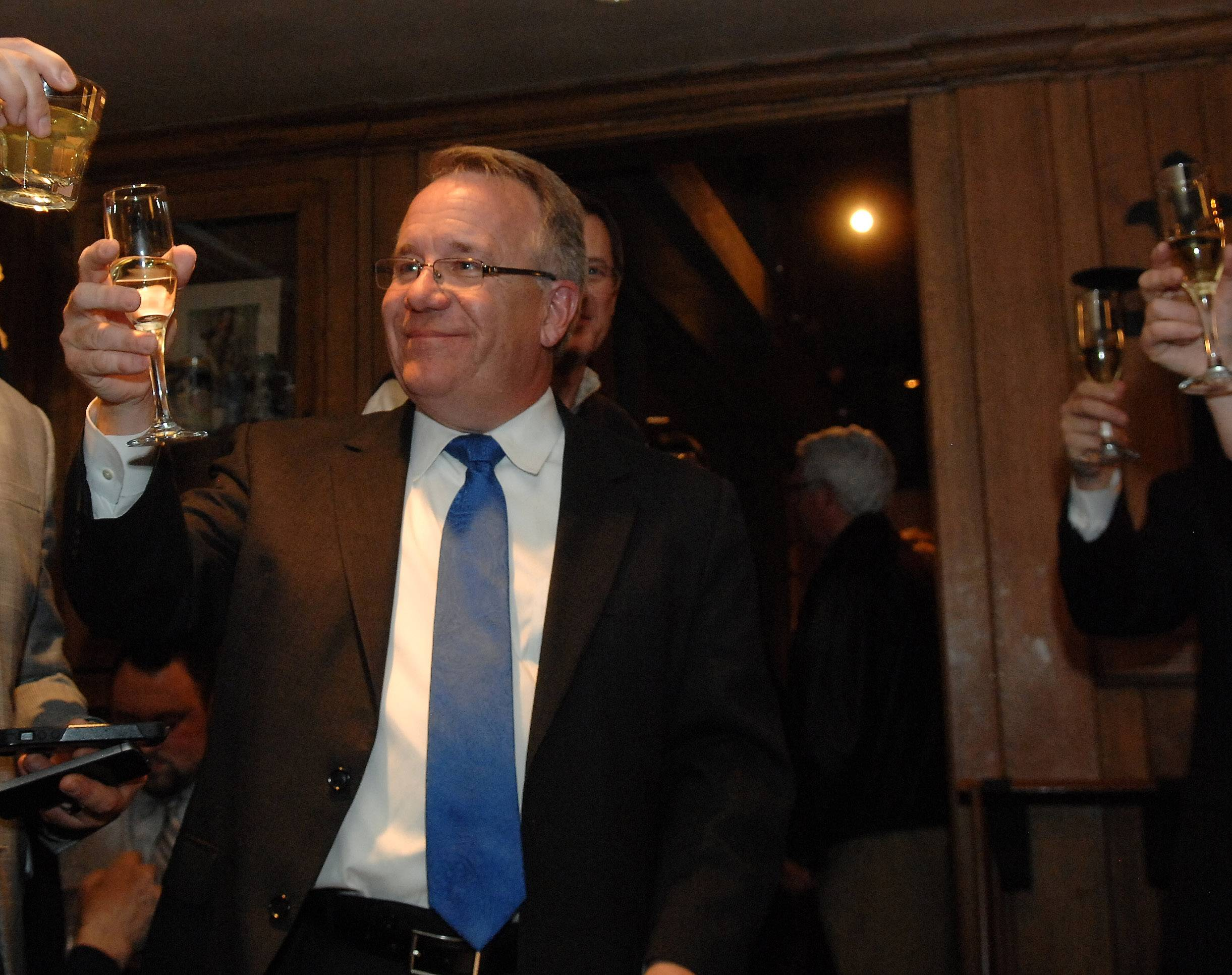 Everyone raises a glass to toast Steve Andersson of Geneva after his victory speech at the Village Squire in South Elgin Tuesday. He won the Republican nomination for state 65th House District.