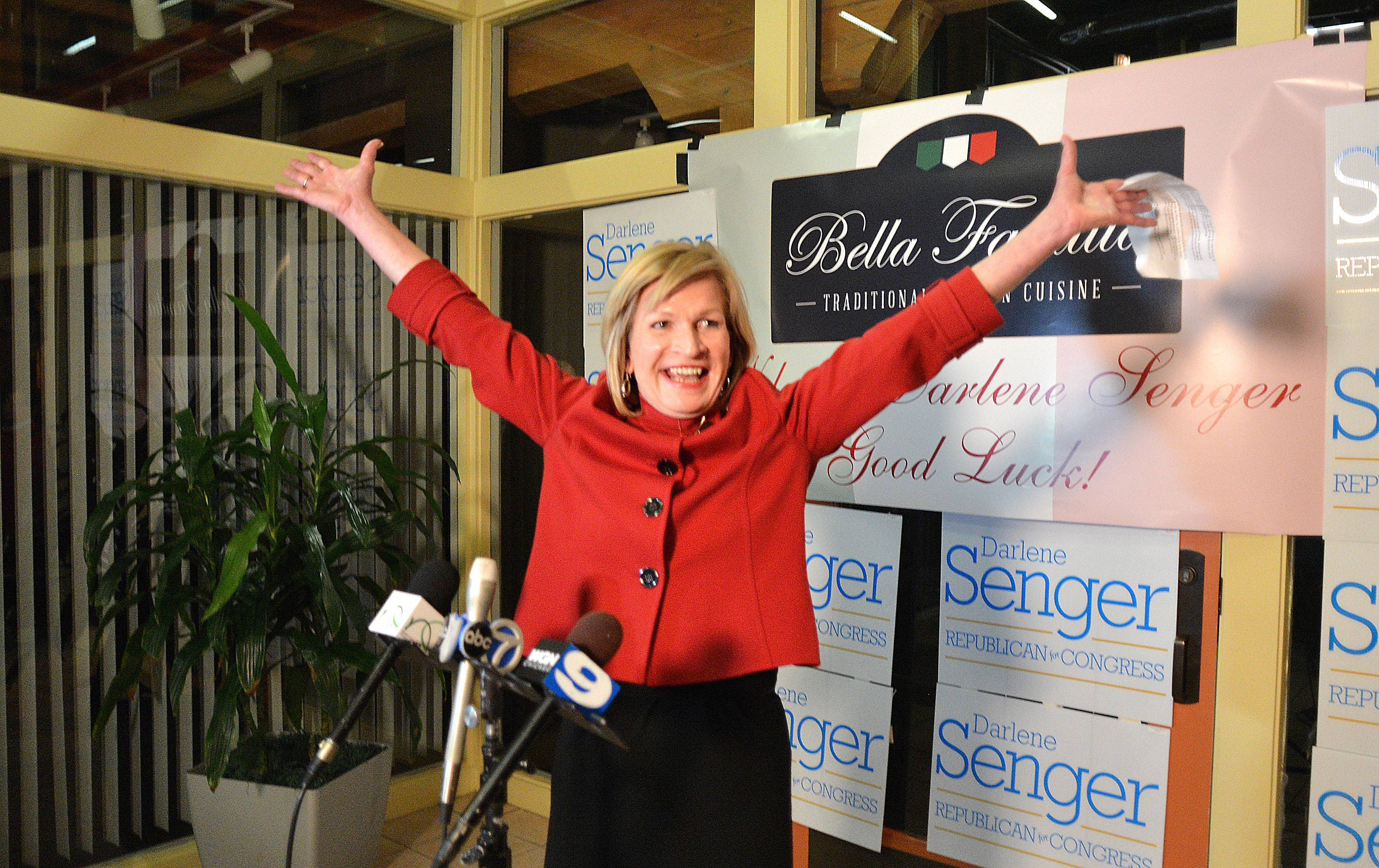 Darlene Senger of Naperville celebrates Tuesday night after winning the Republican nomination in the 11th Congressional District. She'll move on to face Democratic incumbent Bill Foster in the general election.