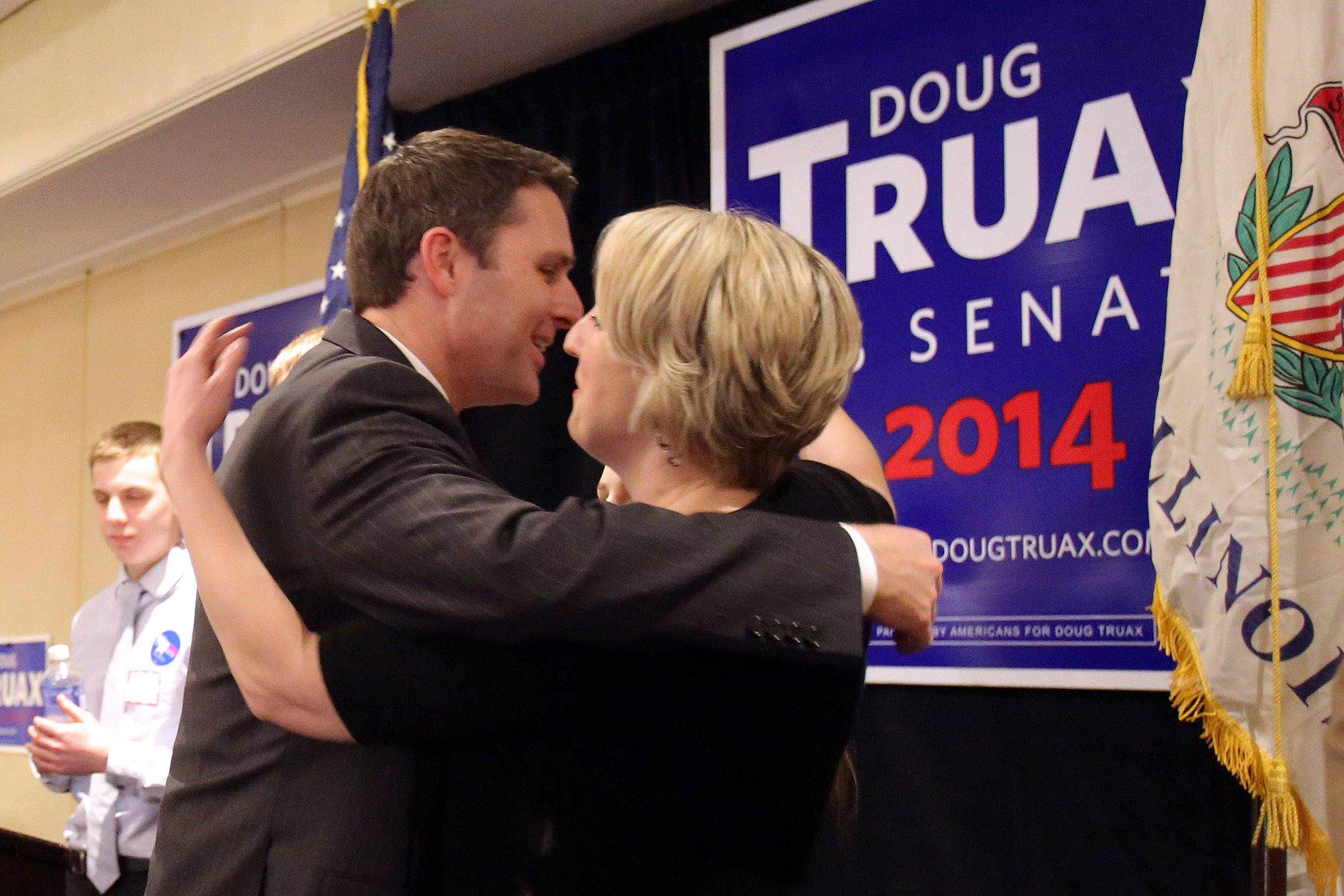 Republican U.S. Sen. candidate Doug Truax, left, hugs his wife after conceding to Jim Oberweis at the Oak Brook Marriott Tuesday.