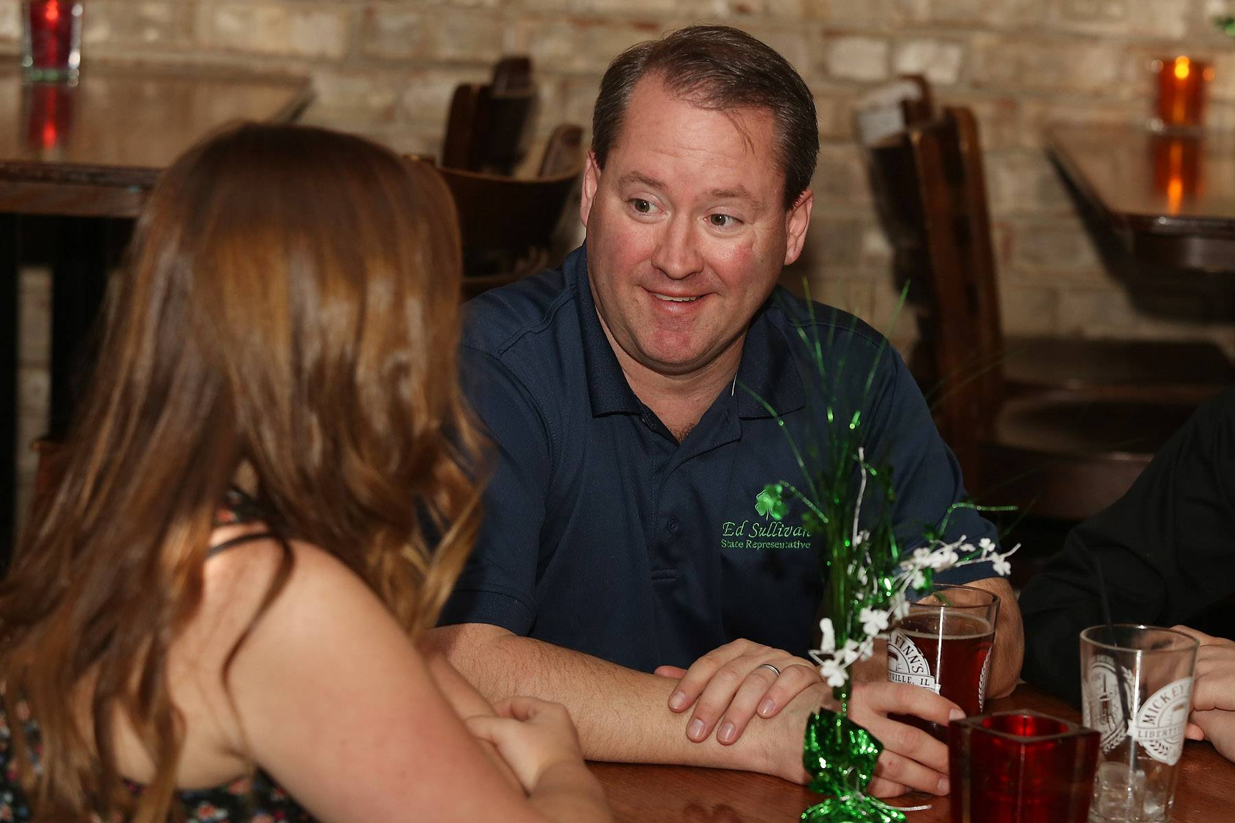 51st State House candidate Ed Sullivan Jr. smiles as he talks about the primary election with his niece, Jessica Gallimore, at Mickey Finn's in Libertyville. Sullivan's opponent  was Bob Bednar.