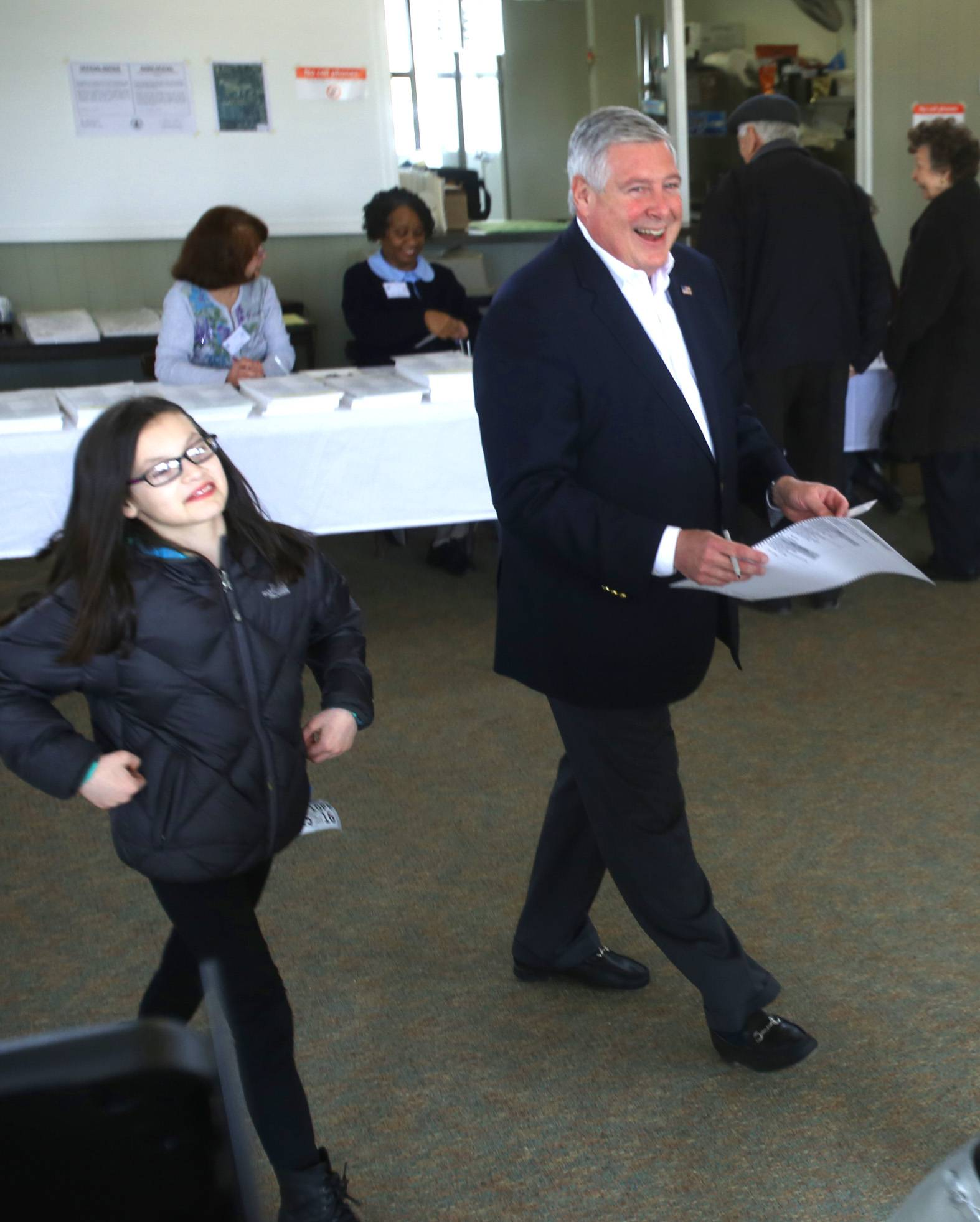 State Sen. Kirk Dillard casts his ballot at the Salt Creek Club in Hinsdale. His daughter Ava, 10, is at his side.