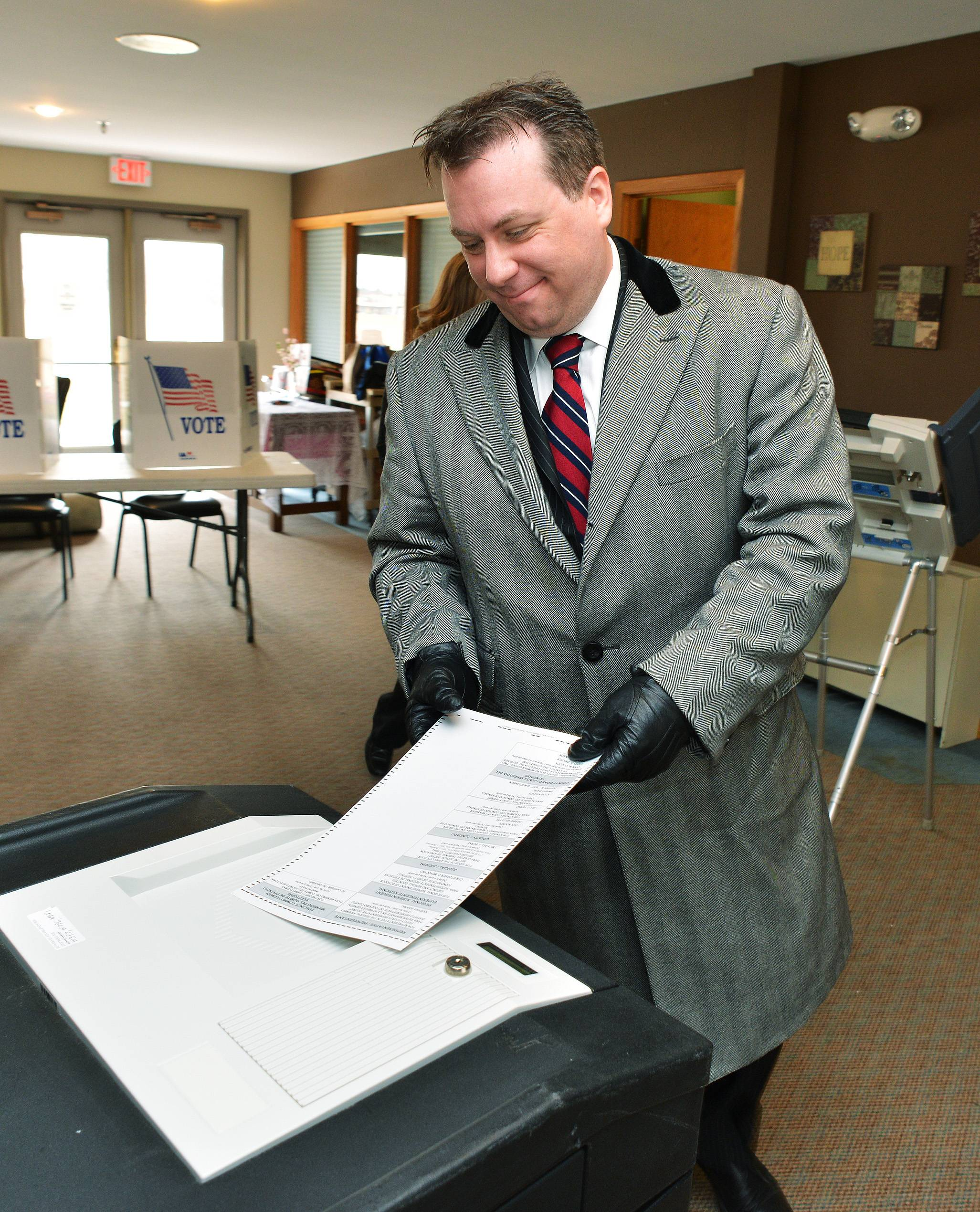 11th Congressional Candidate Ian Bayne of Aurora casts his vote Tuesday morning in Aurora.