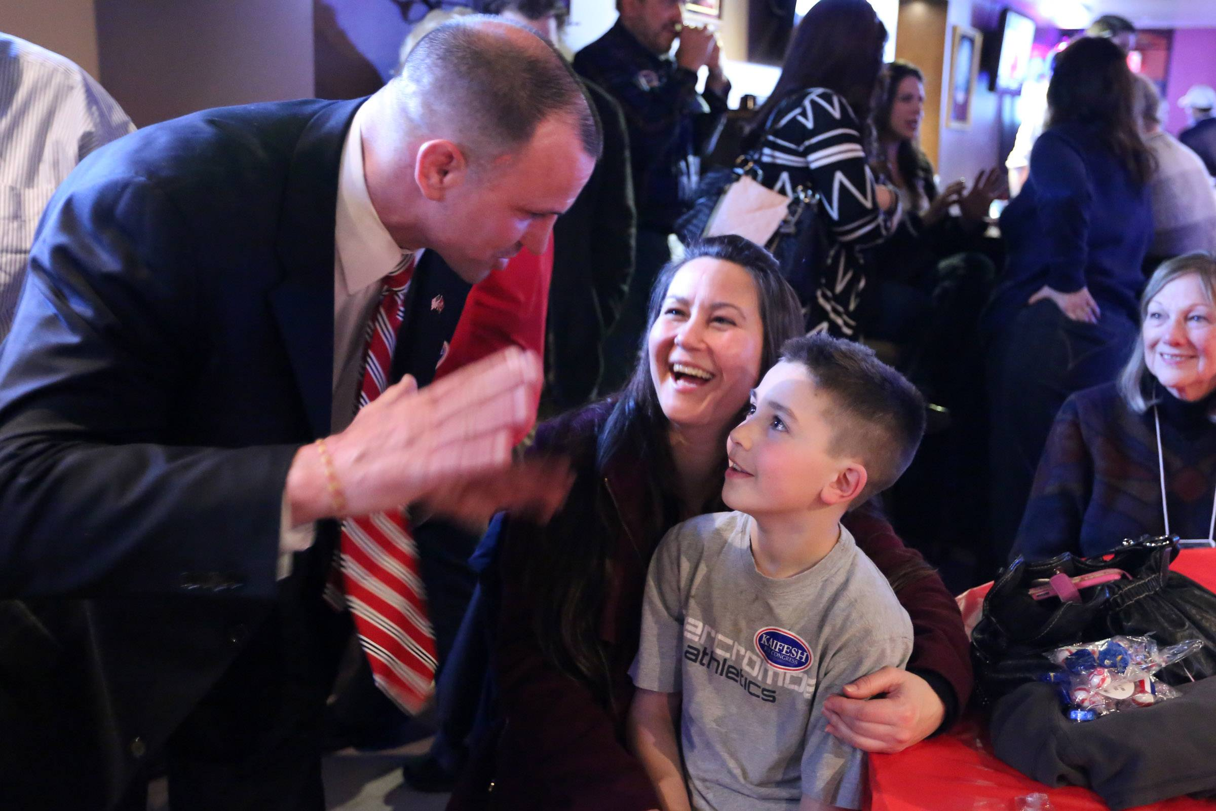 Larry Kaifesh says thank you to supporters at Strike Ten Lanes on Tuesday in Roselle after claiming victory and the Republican nomination in the 8th Congressional District.  Here, he talks with supporter Traci Piersson and her son, Kylar, 9, both of Schaumburg.