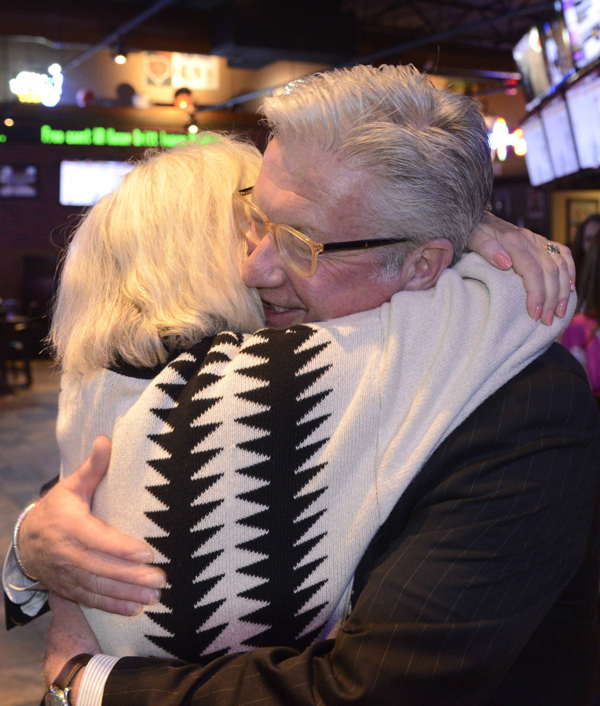 Dennis Anderson, Democratic candidate for the 14th Congressional District,embraces his wife Susan Glad-Anderson after claiming victory.