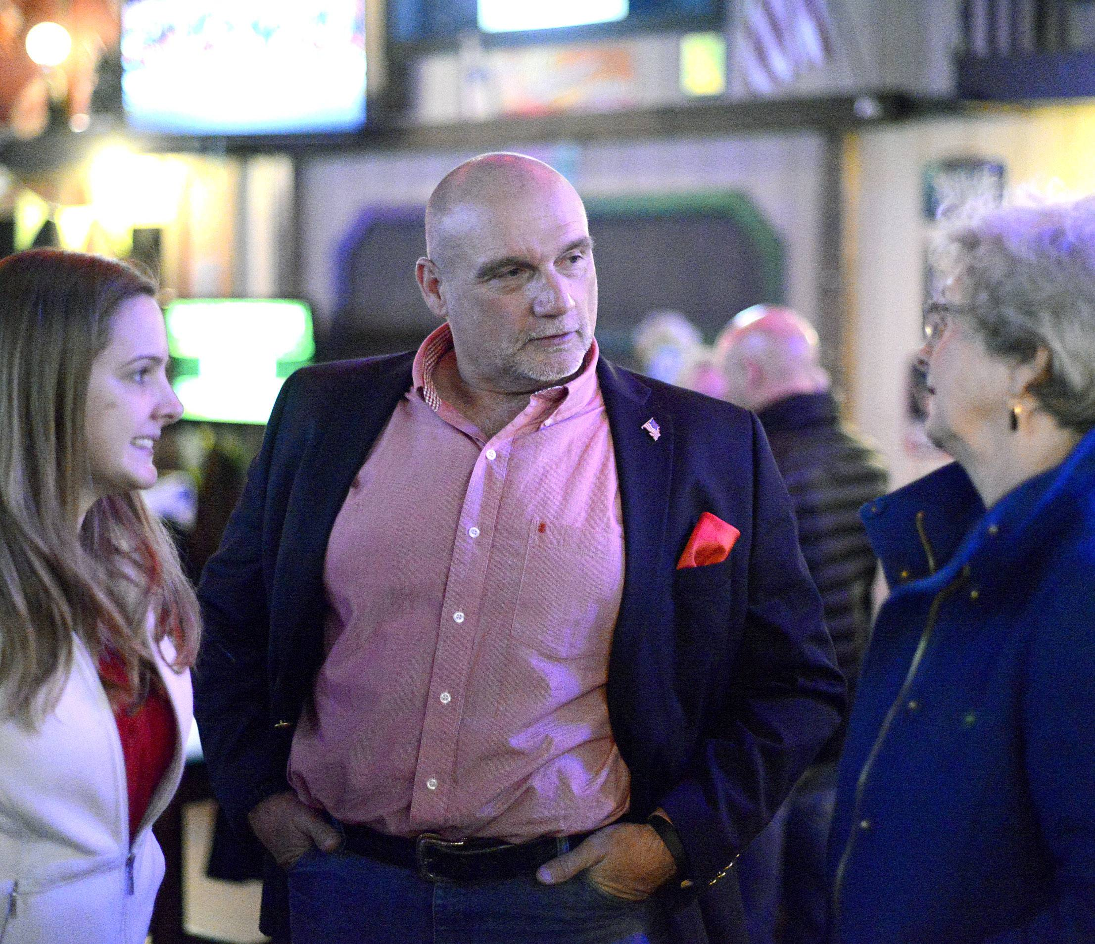 Kane County Sheriff candidate Lt. Kevin Williams, center, chats with Kane County Recorder Sandy Wegman, right, and her daughter Penny Wegman, both of Elgin at his election night gathering in St. Charles.