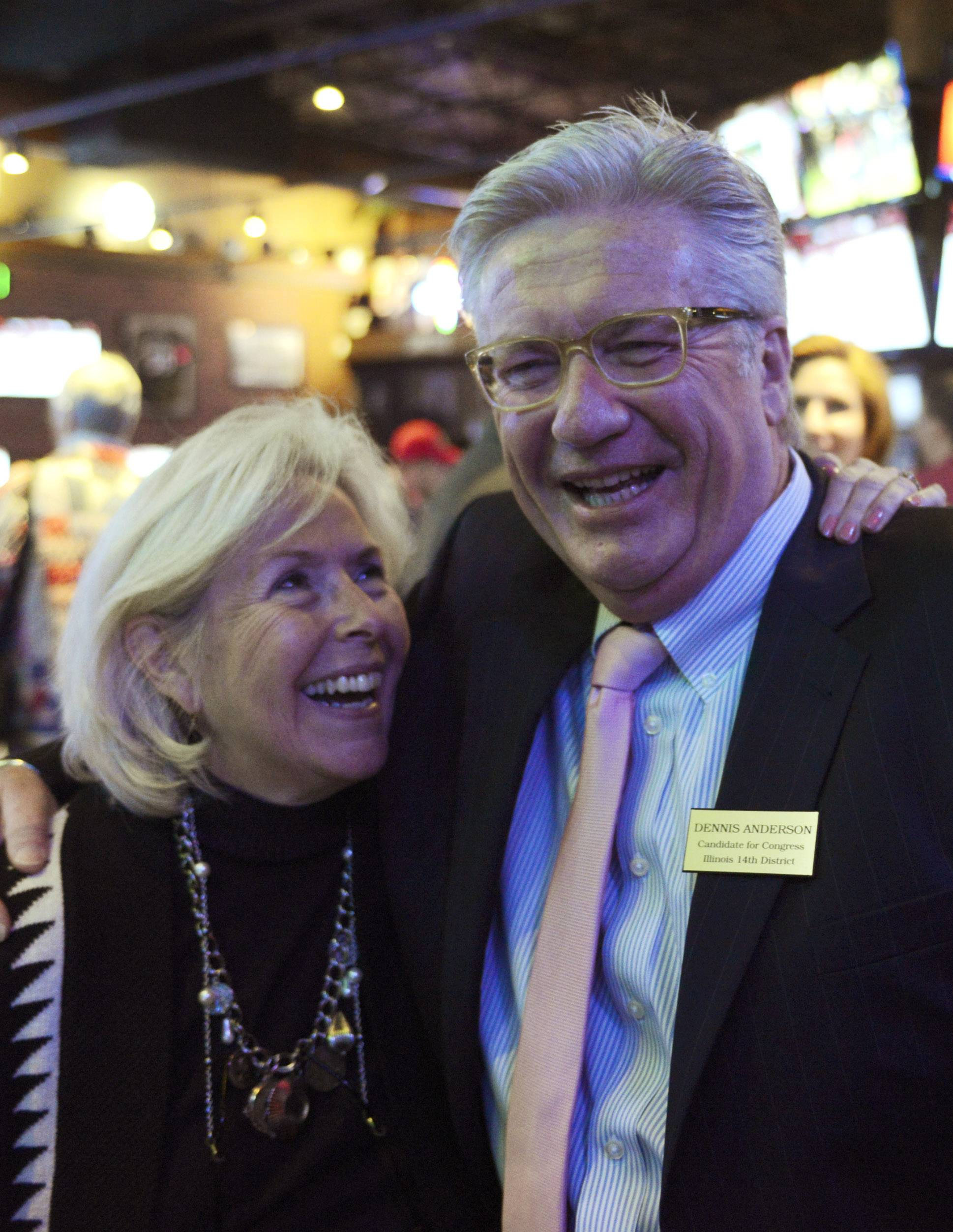 Democrat Dennis Anderson celebrates with his wife, Susan Glad-Anderson, following his primary victory Tuesday night.